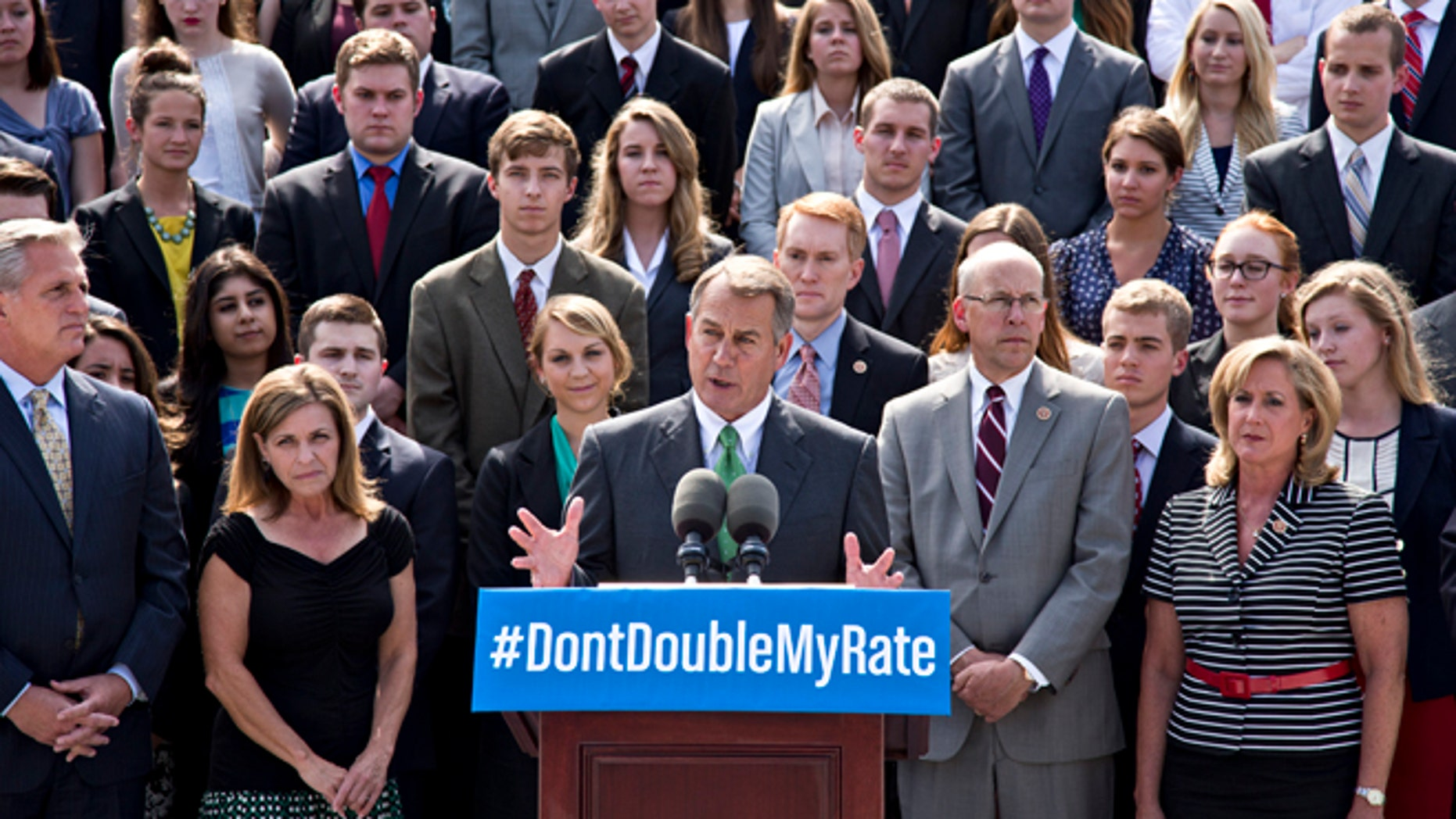 In this July 8, 2013, photo, with a backdrop of college students on the step of the House of Representatives, Speaker of the House John Boehner, R-Ohio, center, and GOP leaders talk about the politics of federal student loan rates which doubled on July 1, at the Capitol in Washington. (AP Photo/J. Scott Applewhite)