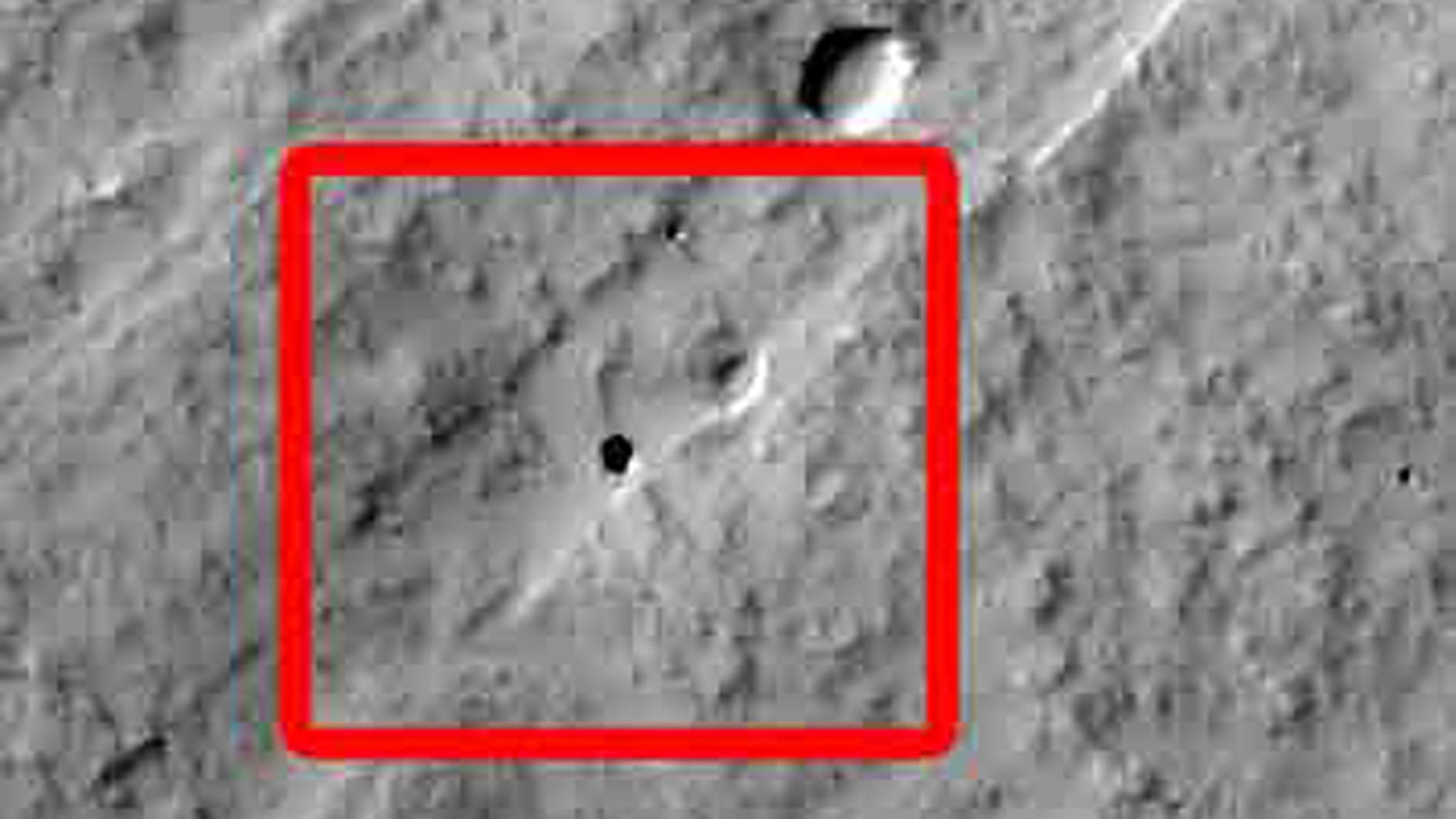 California 7th graders discovered this Martian pit feature at the center of the superimposed red square in this image while participating in a program that enables students to use the camera on NASA's Mars Odyssey orbiter. The feature, on the slope of an equatorial volcano named Pavonis Mons, appears to be a skylight in an underground lava tube.