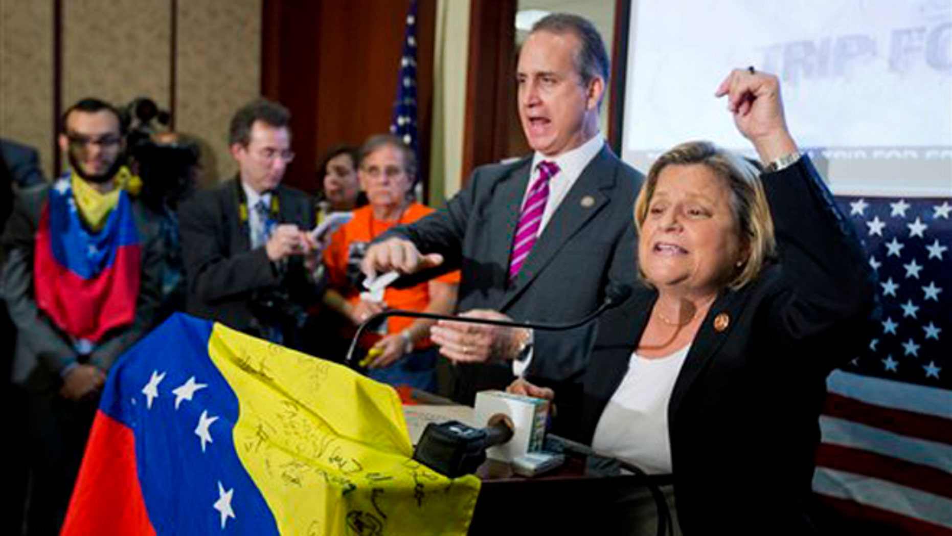 Rep. Ileana  Ros-Lehtinen, R-Fla., right, and Rep. Mario  Diaz-Balart, R-Fla., join Venezuelan-Americans gathered on Capitol Hill in Washington, Friday, May 9, 2014, to pressure the Obama administration to implement sanctions on the regime of Nicolas Maduro, the president of Venezuela. (AP Photo/Manuel Balce Ceneta)