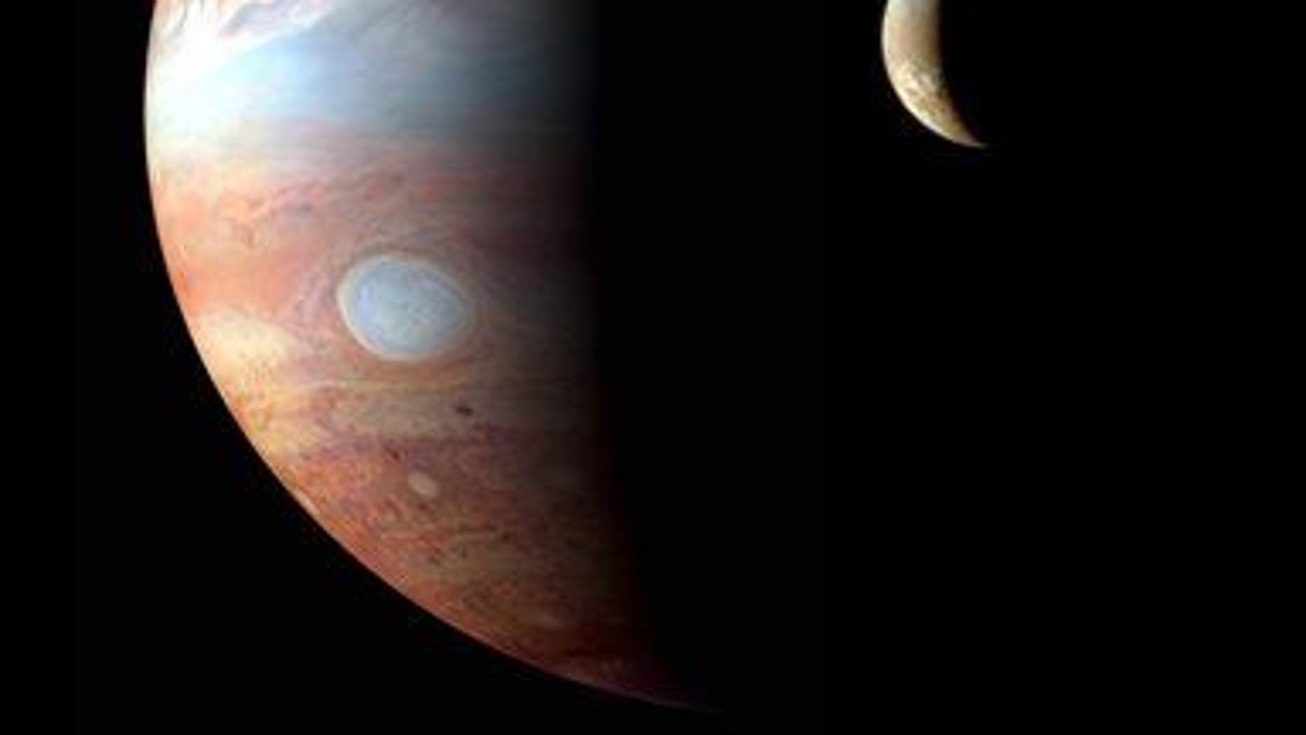 This image provided by NASA shows a montage of New Horizons images of Jupiter and its volcanic moon Io, taken during the spacecraft���s Jupiter flyby.