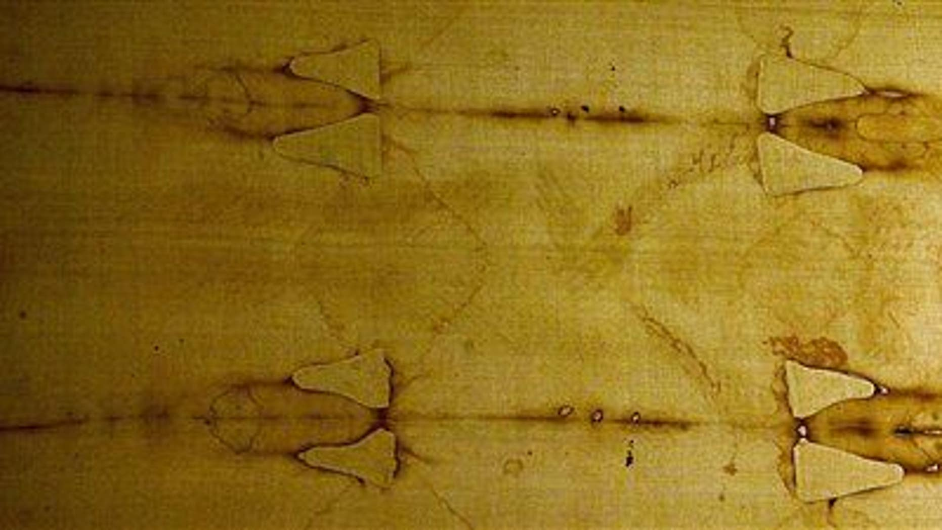 This Saturday, August 12, 2000 file photo shows the Holy Shroud, a 14 foot-long linen revered by some as the burial cloth of Jesus.