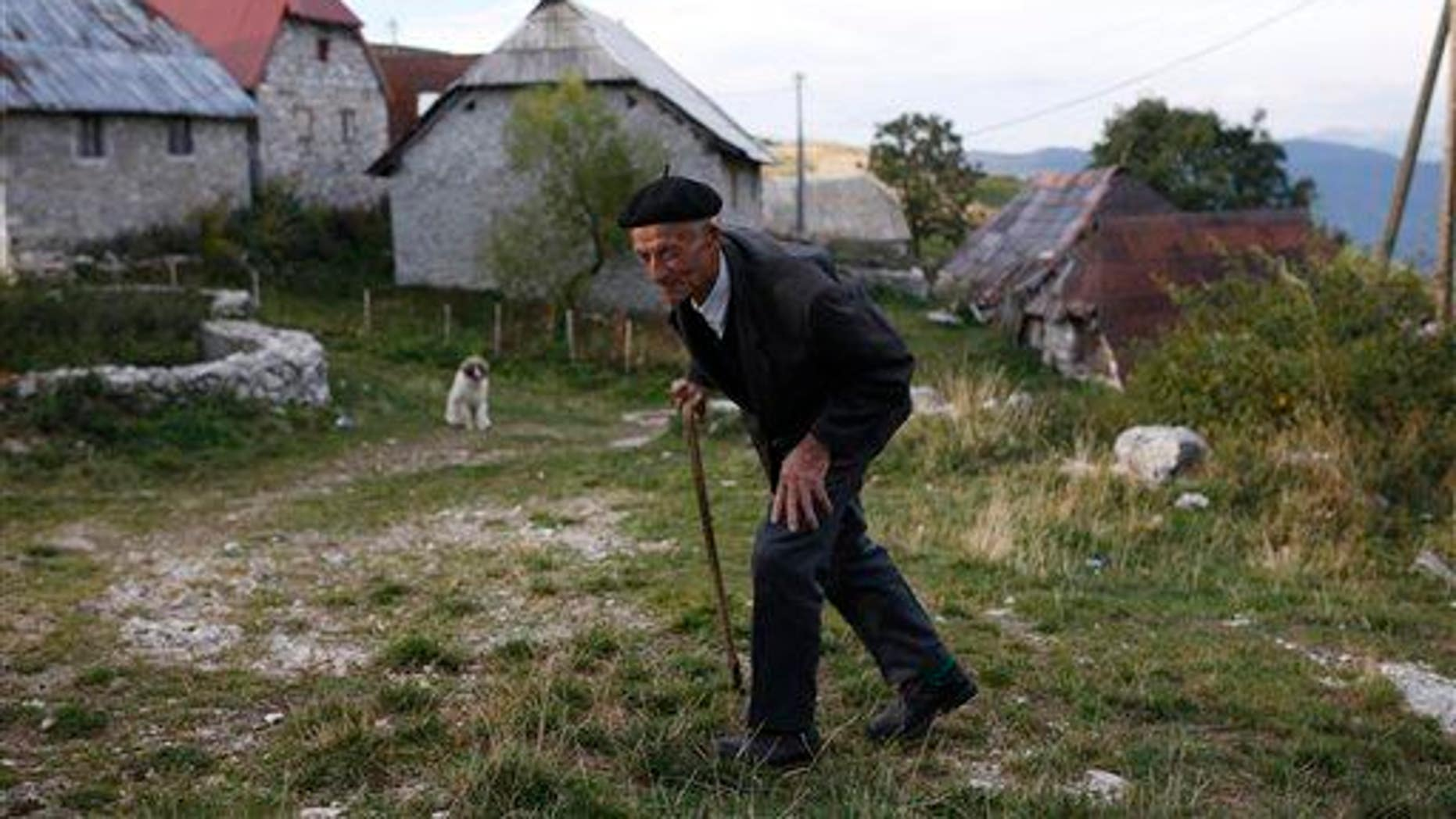 An elderly man walks in the remote mountain village of Lukomir, south of Sarajevo, Bosnia,  on Sept. 24, 2015.
