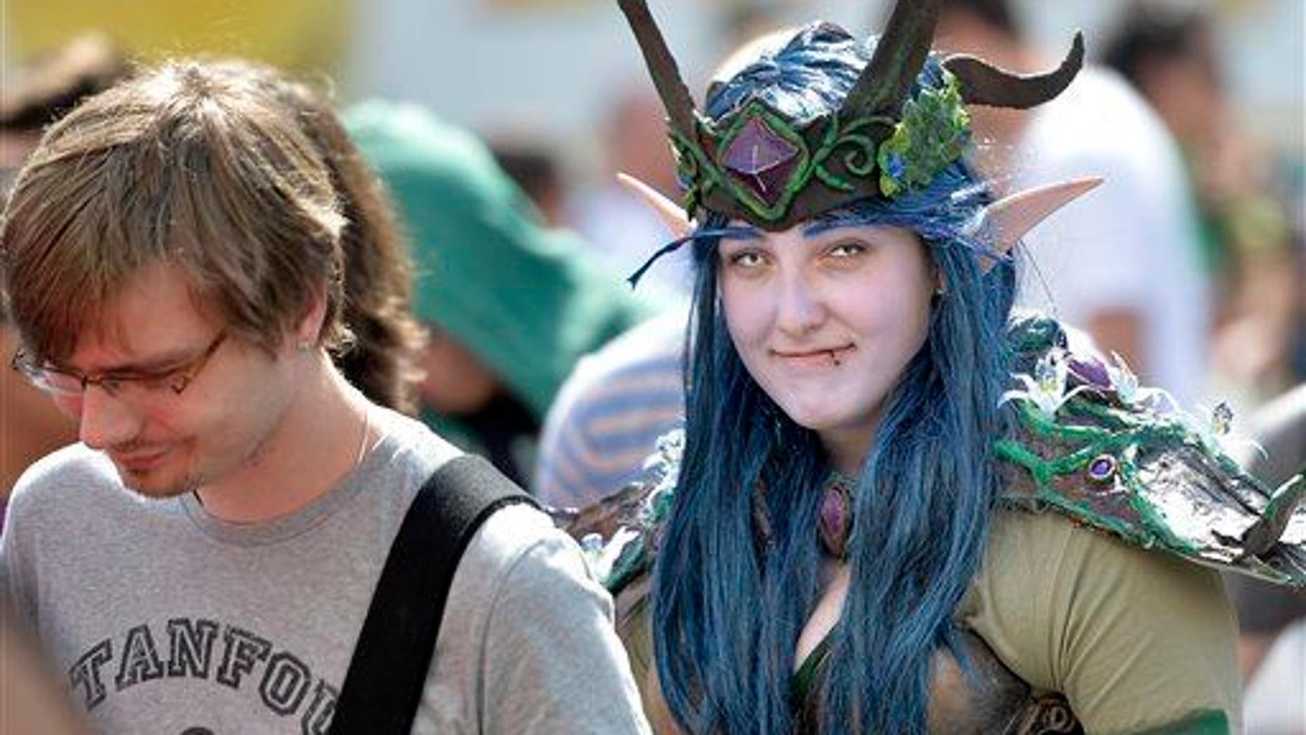 A girl in a fantasy dress  arrives at gaming fair in Cologne, Germany, in this file photo.