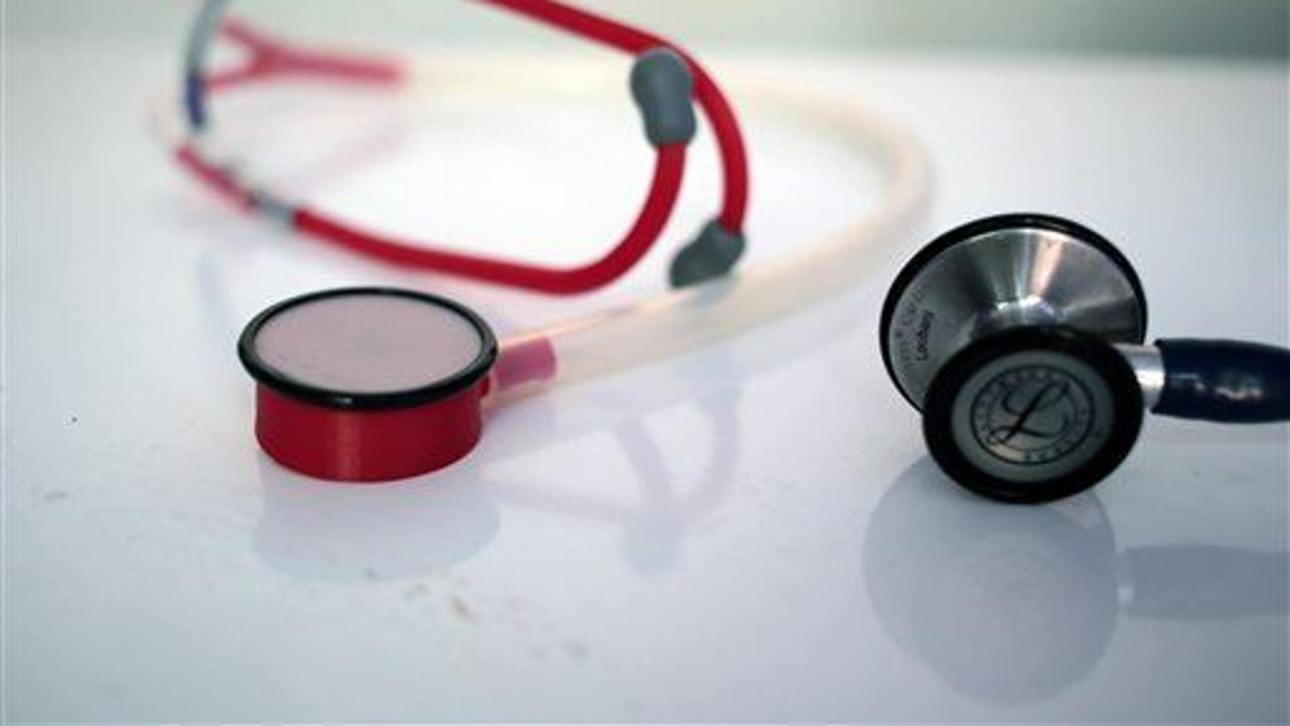 In this Monday, Sept. 7, 2015 photo, a 3D printed stethoscope, left, is seen next to a traditional medical stethoscope in Gaza City. In a territory lacking many basic medical supplies, Dr. Tarek Loubani says he has designed a stethoscope that can be made by a 3-D printer for just $2.50 _ a fraction of the cost of leading brands. Some doctors say the equipment is just as good. (AP Photo/ Khalil Hamra)