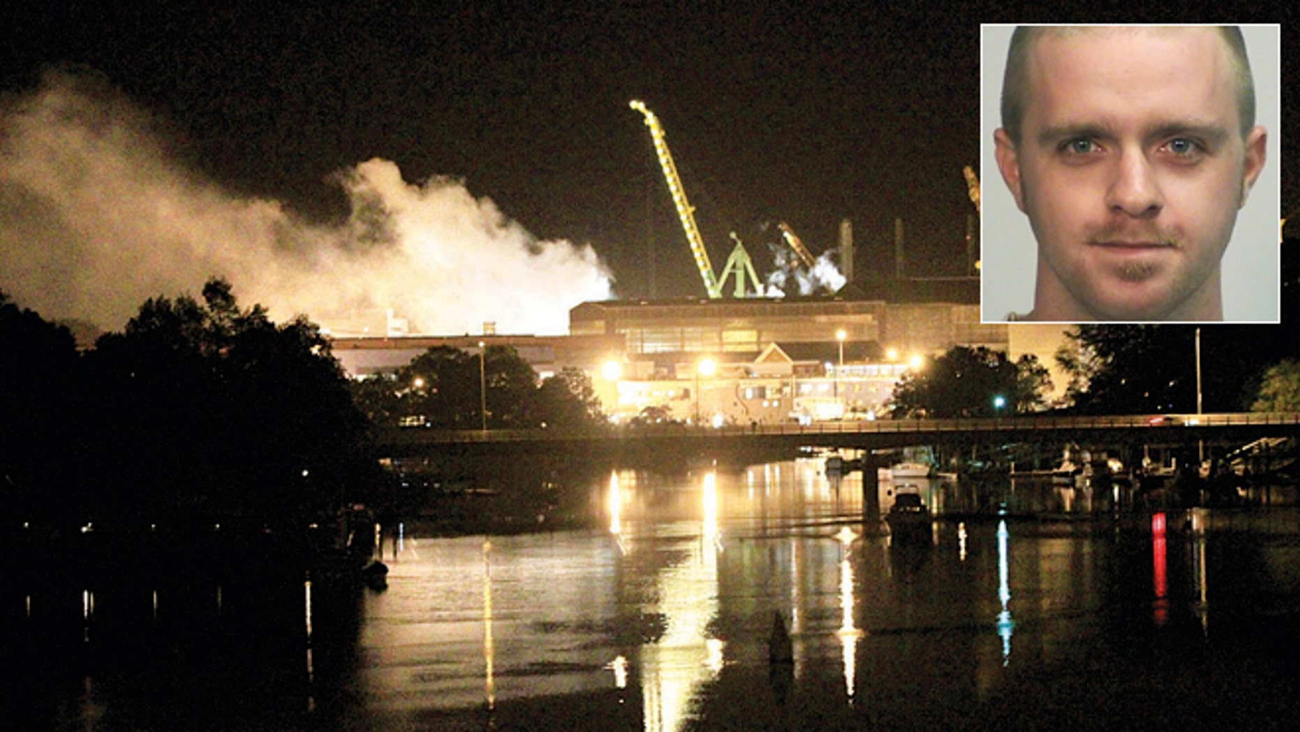 FILE: Smoke rises from a dry dock as fire crews respond to a fire on the USS Miami SSN 755 submarine at the Portsmouth Naval Shipyard. Casey James Fury waived indictment and pleaded guilty Thursday to two counts of arson.