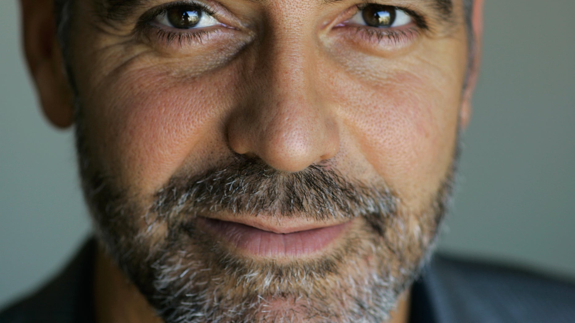 In this 2007 file photo, George Clooney poses for a portrait during the Toronto International Film Festival.  A group founded by Clooney said Dec. 28 it teamed up with Google, a U.N. agency and anti-genocide organizations to launch satellite surveillance of the border between north and south Sudan to try to prevent a new civil war.