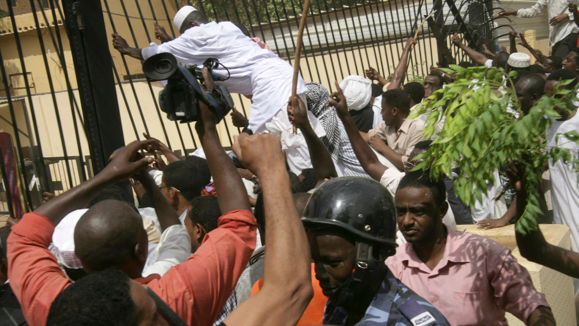 Friday, Sept. 14, 2012: Sudanese protesters and riot police face off during a protest outside the German embassy in Khartoum, Sudan.