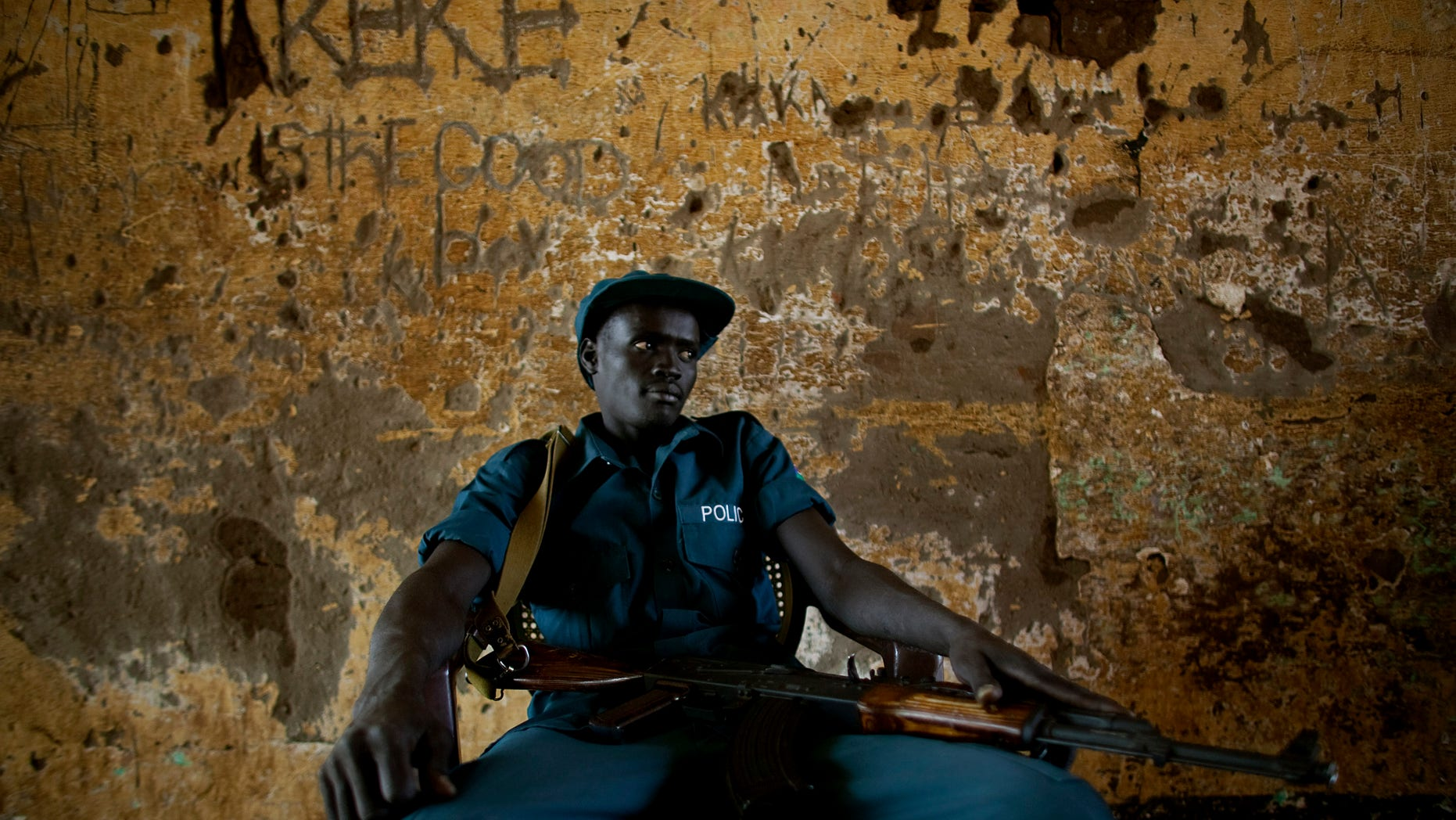 Jan. 9, 2011: A southern Sudanese police officer on security detail outside a polling station in the southern Sudanese capital of Juba. Women broke out in song and men wrapped themselves in flags as voters in Southern Sudan began casting ballots Sunday in a weeklong independence referendum likely to create the world's newest nation about five years after the end of a brutal civil war. The mainly Christian south is widely expected to secede from the mainly Muslim north, splitting Africa's largest country in two. (AP)