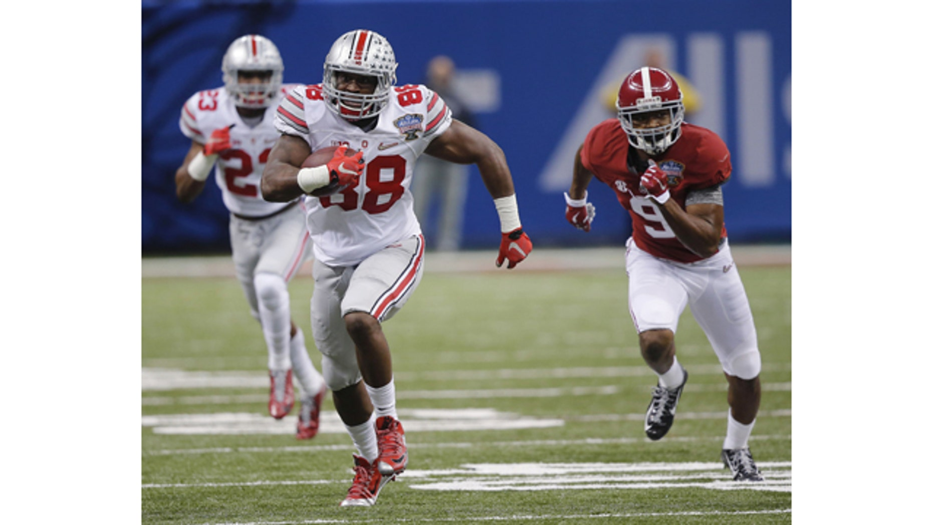 Jan. 1, 2015: Ohio State defensive lineman Steve Miller (88) returns an interception against Alabama in the second half of the Sugar Bowl NCAA college football playoff semifinal game in New Orleans. (AP Photo/Bill Haber)