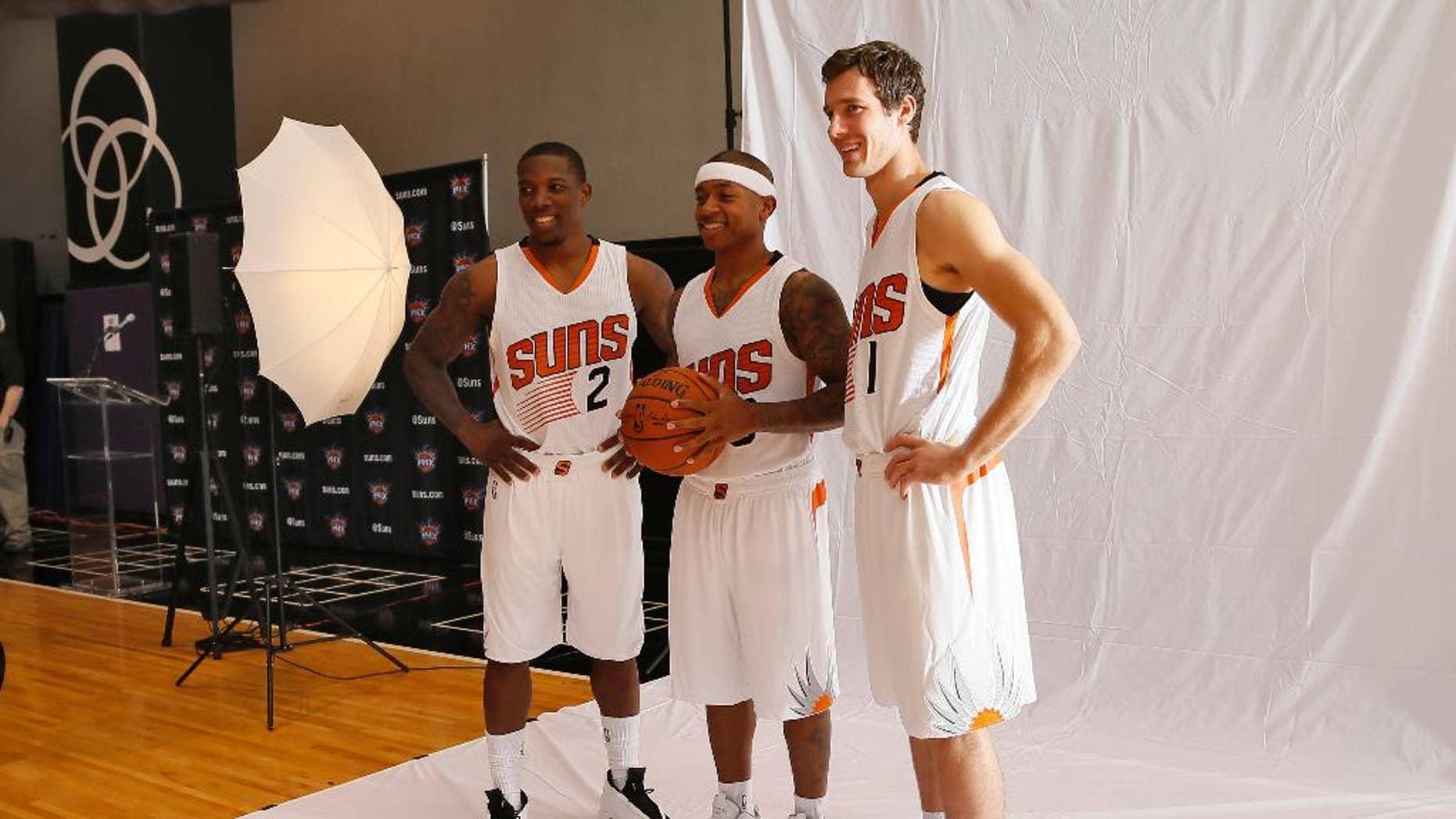 Phoenix Suns' Goran Dragic (1), of Slovenia, Isaiah Thomas, center, and Eric Bledsoe pose for a photo during NBA basketball media day, Monday, Sept. 29, 2014, in Phoenix. (AP Photo/Matt York)