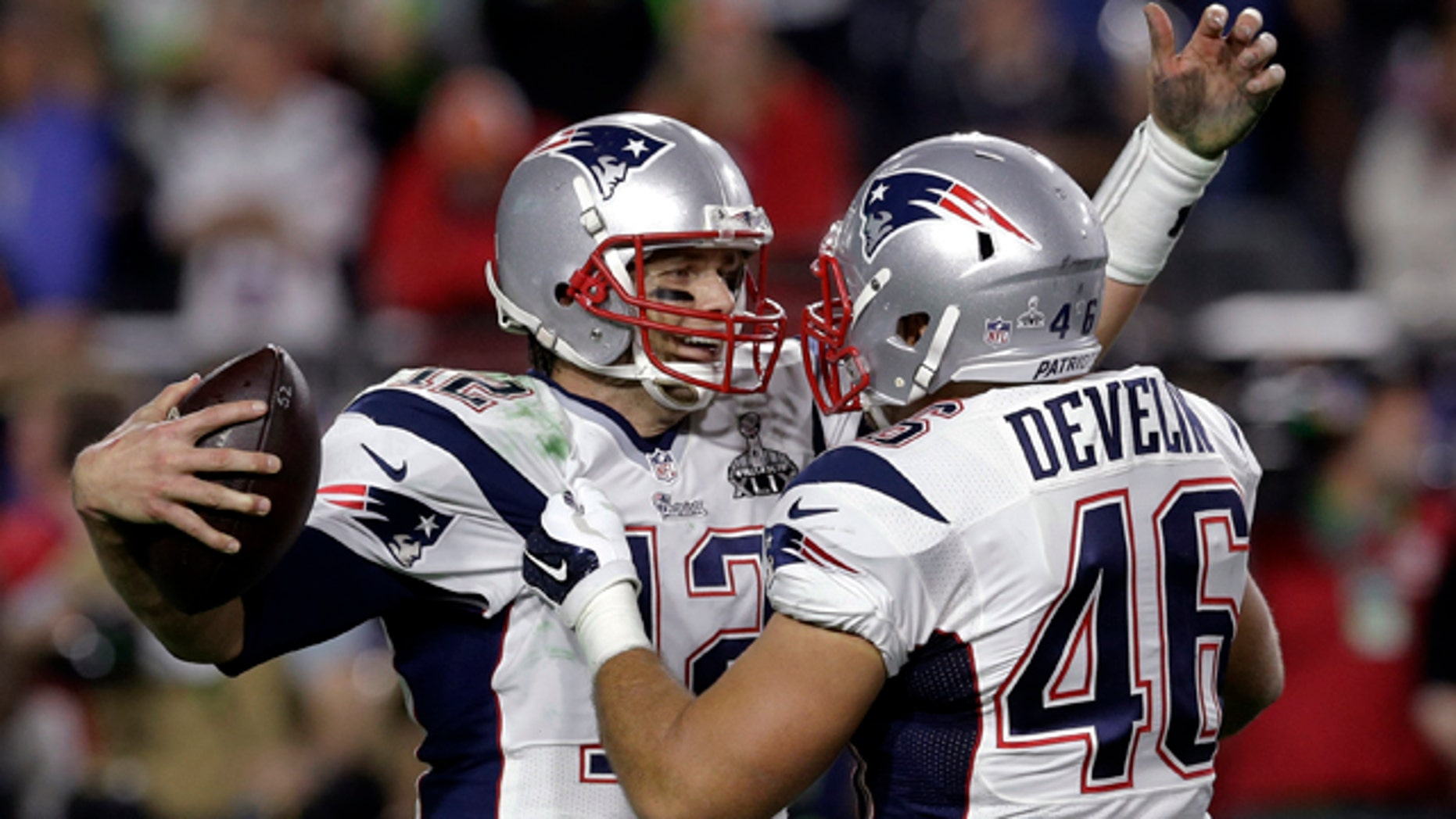 Feb. 1, 2015: New England Patriots quarterback Tom Brady (12) celebrates with New England Patriots fullback James Develin (46) after NFL Super Bowl XLIX football game against the Seattle Seahawks in Glendale, Ariz. (AP Photo/Patrick Semansky)