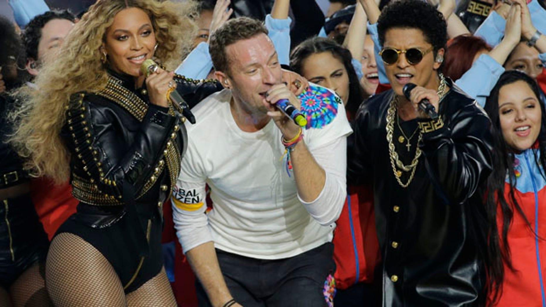 Feb. 7, 2016: Beyoncé, Coldplay singer Chris Martin and Bruno Mars perform during halftime of Super Bowl 50 in Santa Clara, Calif. (AP Photo/David J. Phillip)