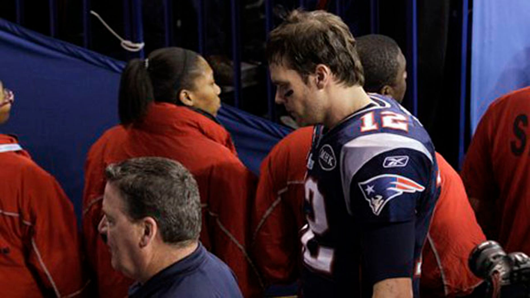 Feb. 5, 2012: New England Patriots quarterback Tom Brady leaves the field after Super Bowl loss.