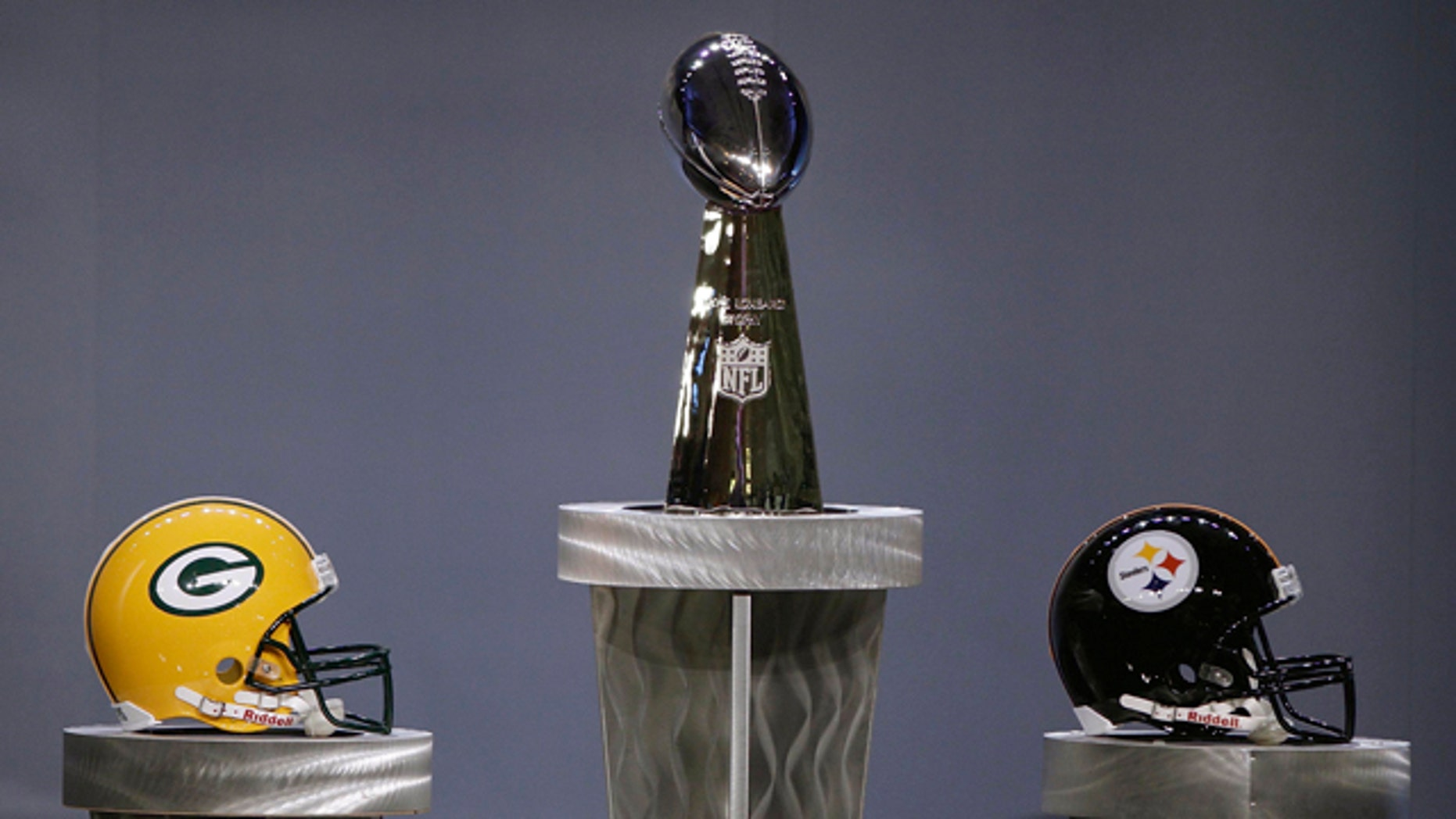 Feb. 4: The Vince Lombardi Trophy is displayed with the team helmets before a news conference at the Super Bowl XLV Media Center in Dallas.