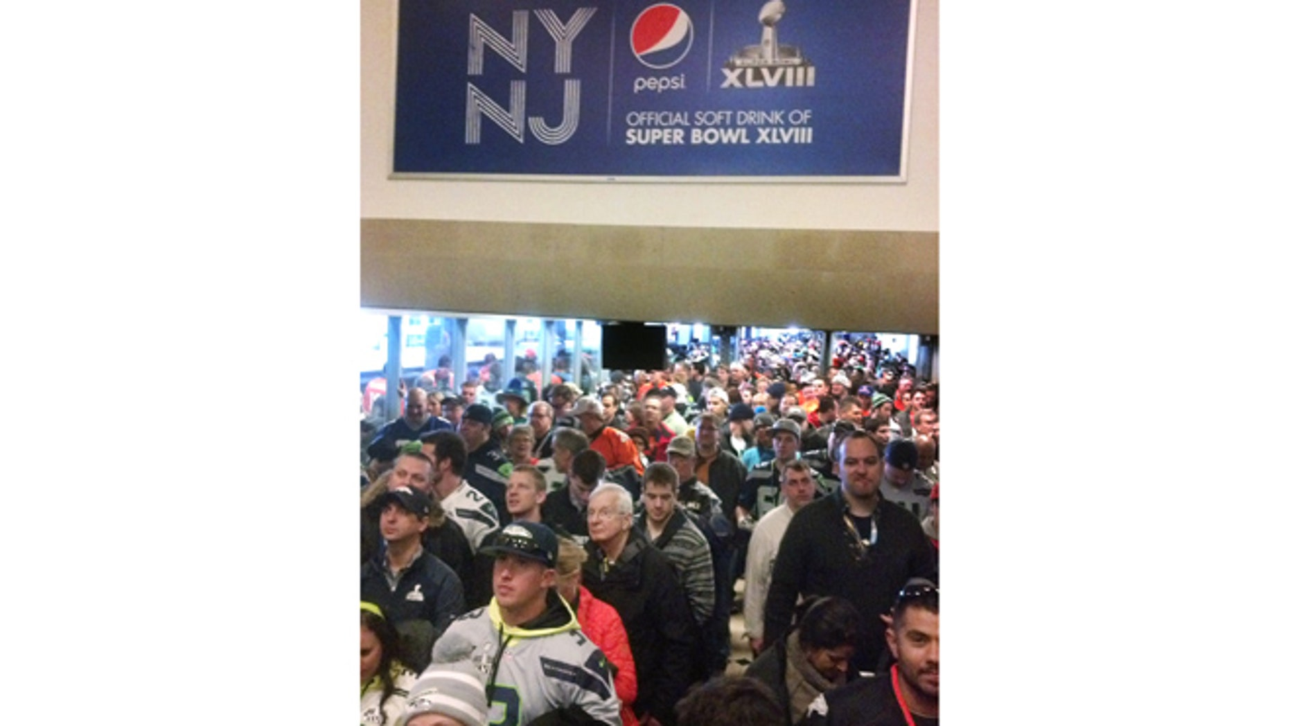 Feb. 2, 2014: Fans from Manhattan bound for MetLife Stadium and the Super Bowl crowd a NJ Transit station in Secaucus, N.J.