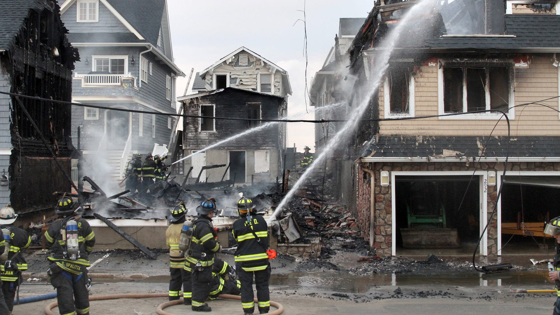 Dec. 5, 2012: Manasquan Firefighters work on the scene of a multi house fire on First Avenue on the beachfront in Manasquan, N.J.