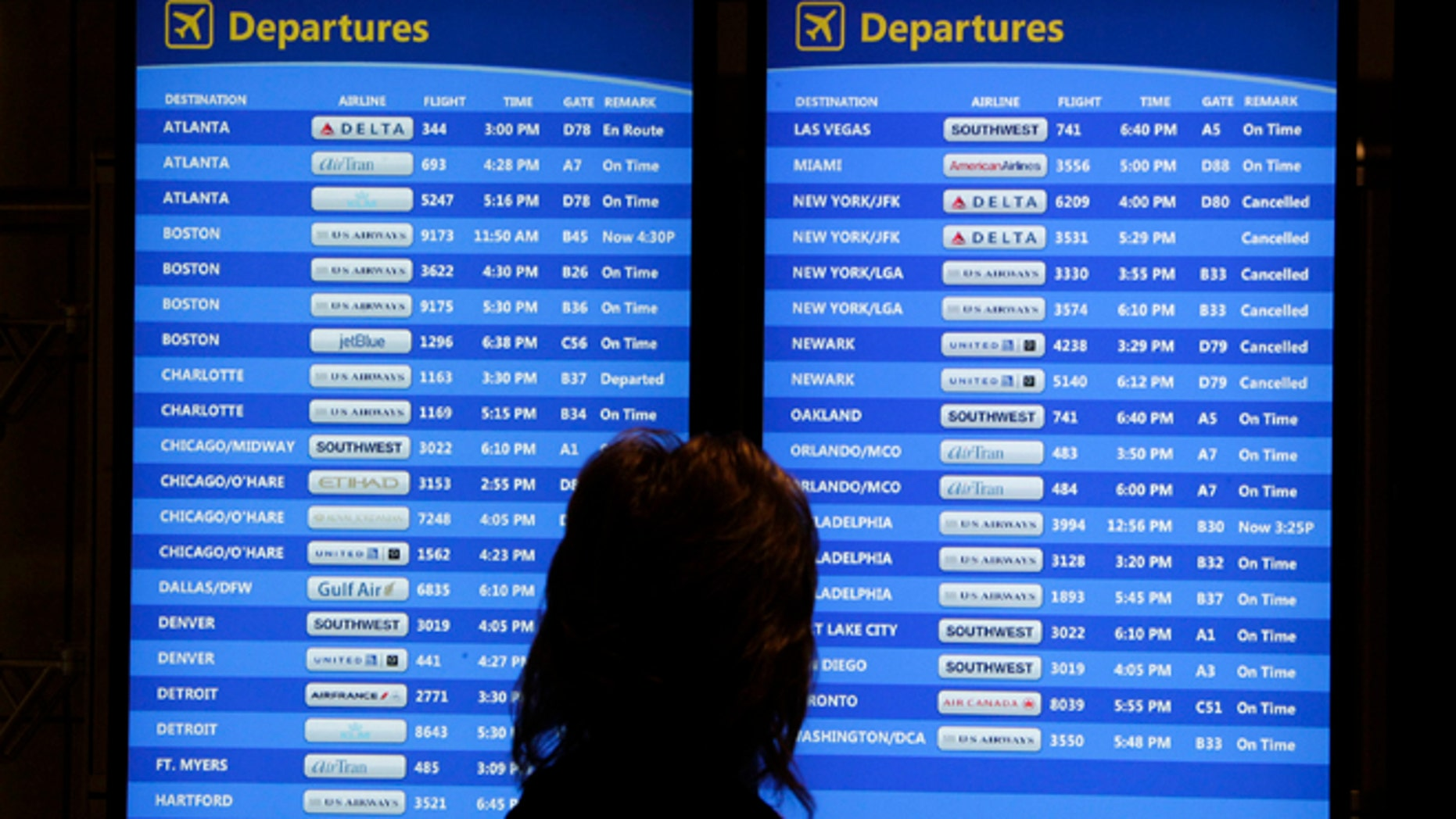 Oct. 31, 2012: A passenger checks the departures board at Pittsburgh International Airport.