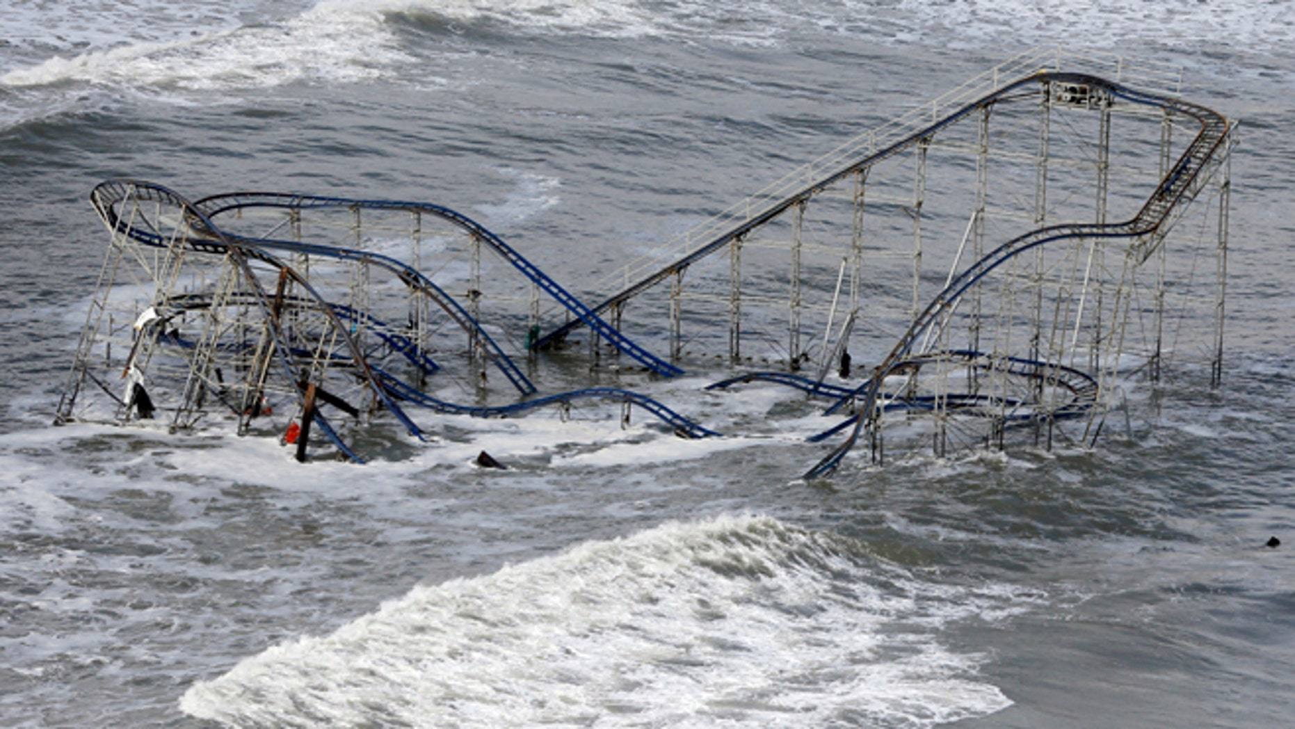Oct. 31: Waves wash over a roller coaster from a Seaside Heights, N.J. amusement park that fell in the Atlantic Ocean during Superstorm Sandy.