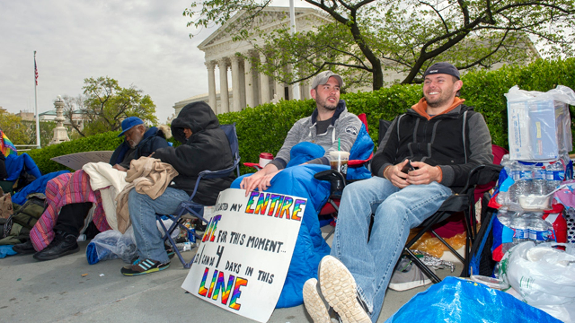 April 27, 2015: Sean Varsho, 28, of Chicago, left, and Brandon Dawson, 26, of Warrenton Va., have been waiting in line for the past three days for a seat for Tuesday's Supreme Court hearing on gay marriage. The opponents of same-sex marriage are urging the court to resist embracing what they see as a radical change in society's view of what constitutes marriage. (AP Photo/Cliff Owen)