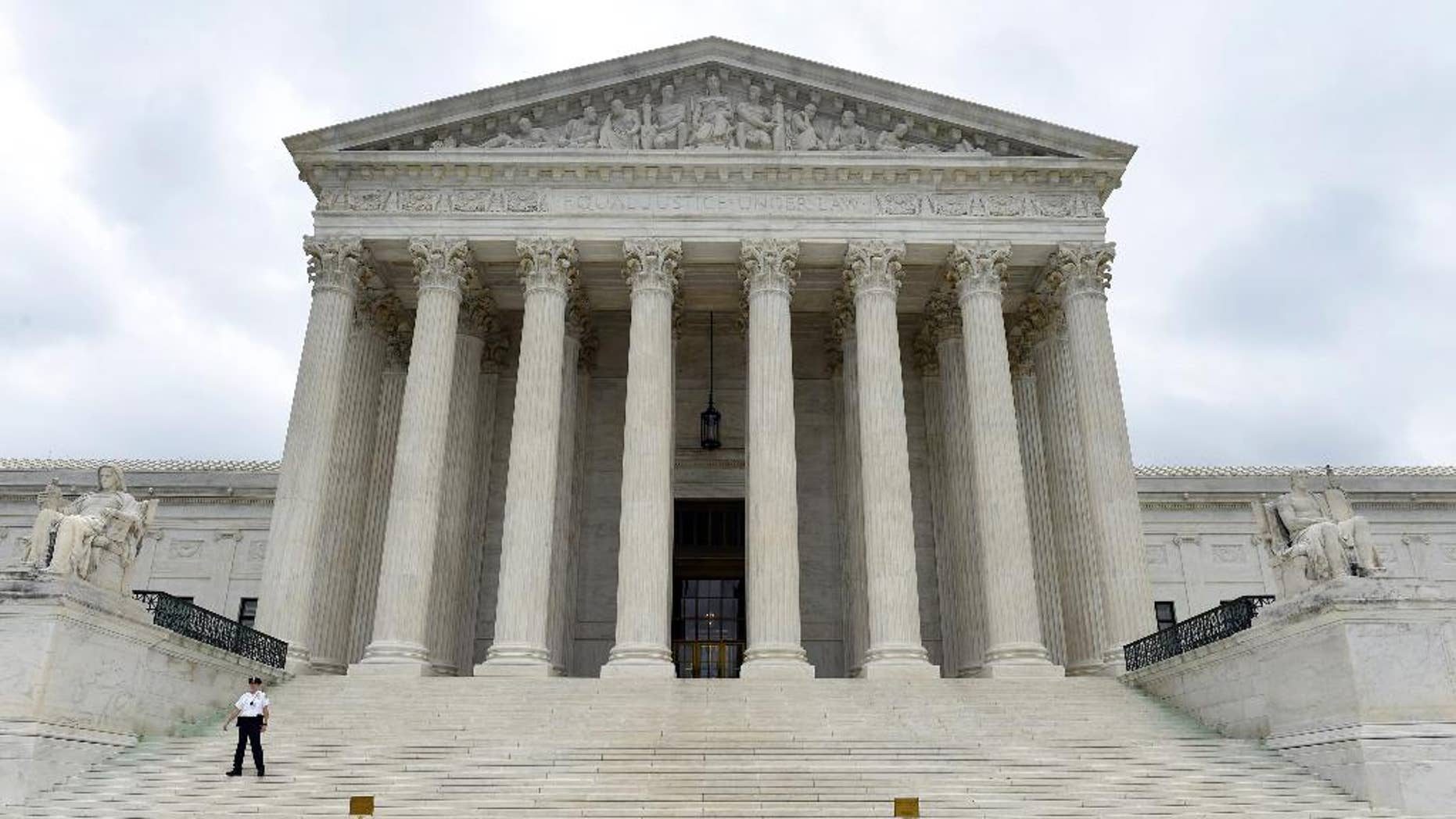 This photo taken Friday, Oct. 3, 2014, shows the U.S. Supreme Court in Washington. A Supreme Court term that is starting Monday, Oct. 6, 2014, with a lack of headline-grabbing cases may end with a blockbuster that helps define the legacy of the court under Chief Justice John Roberts. That's because the justices appear likely to take on the issue of same-sex marriage and decide once and for all whether gay and lesbian couples have a constitutional right to marry.  (AP Photo/Susan Walsh)