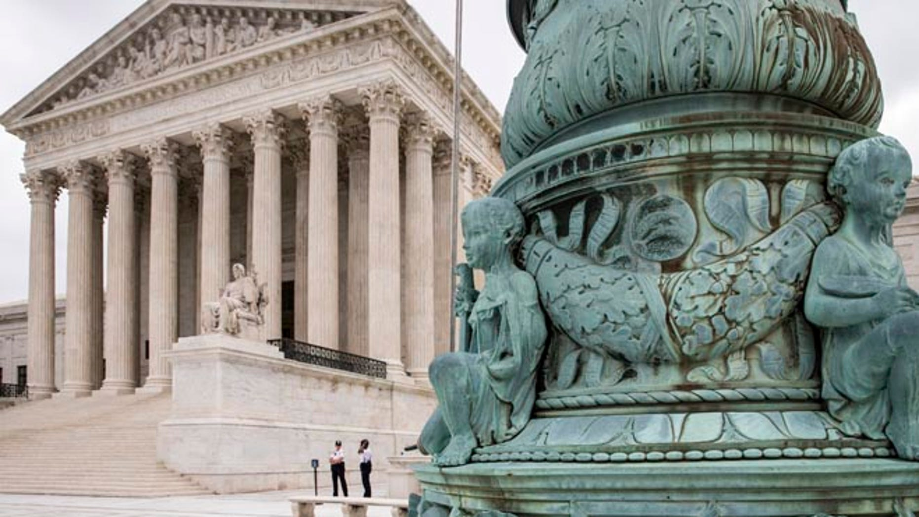 The Supreme Court in Washington is seen Tuesday, May 31, 2016, as the justices ruled unanimously that a Minnesota company could file a lawsuit against the U.S. Army Corps of Engineers over the agency's determination that its land is off limits to peat mining under the Clean Water Act. The high court agreed with the 8th Circuit decision in the case of Hawkes Co., Inc. v. U.S. Army Corps of Engineers to make it easier for landowners to bring a court challenge when federal regulators try to restrict property development due to concerns about water pollution. (AP Photo/J. Scott Applewhite)