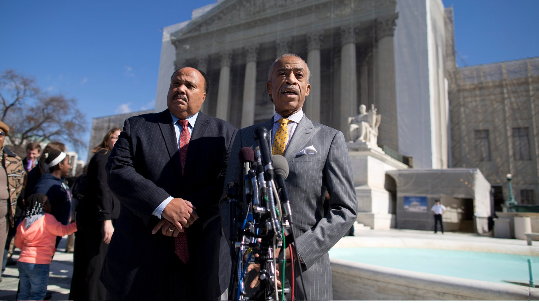 Rev. Al Sharpton, right, and Martin Luther King III meet with reporters outside the Supreme Court in Washington, Wednesday, Feb. 27, 2013, after arguments in the Shelby County, Ala., v. Holder voting rights case.