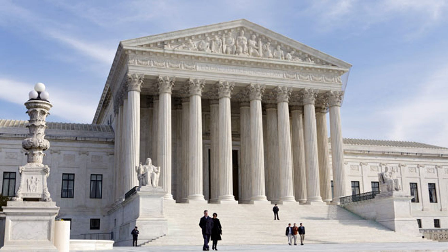 FILE - In this Jan. 25, 2012 file photo, the Supreme Court Building is seen in Washington. The Supreme Court has unanimously upheld a Texas law that counts everyone, not just eligible voters, in deciding how to draw electoral districts.   (AP Photo/J. Scott Applewhite, File)