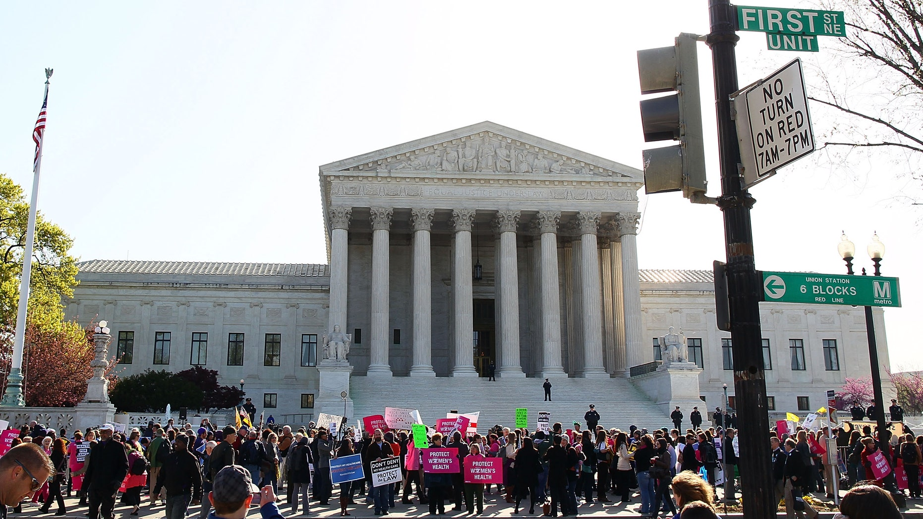 WASHINGTON, DC - MARCH 27:  People participate in a protest on the second day of oral arguments for the Patient Protection and Affordable Care Act in front of the U.S. Supreme Court building on March 27, 2012 in Washington, DC. Today is the second of three days the high court has set aside to hear six hours of arguments over the constitutionality President Barack Obama's Patient Protection and Affordable Care Act.  (Photo by Mark Wilson/Getty Images)
