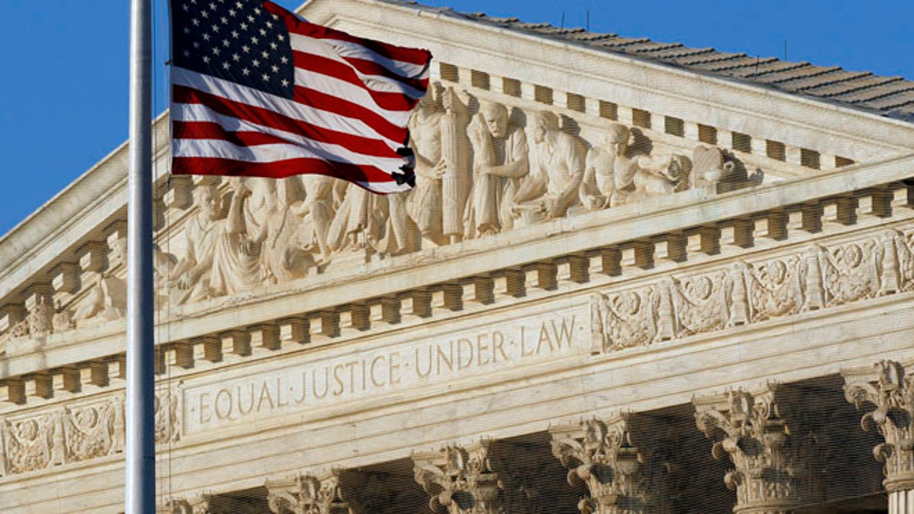 This June 27, 2012, file photo shows an American flag in front of the U.S. Supreme Court in Washington.