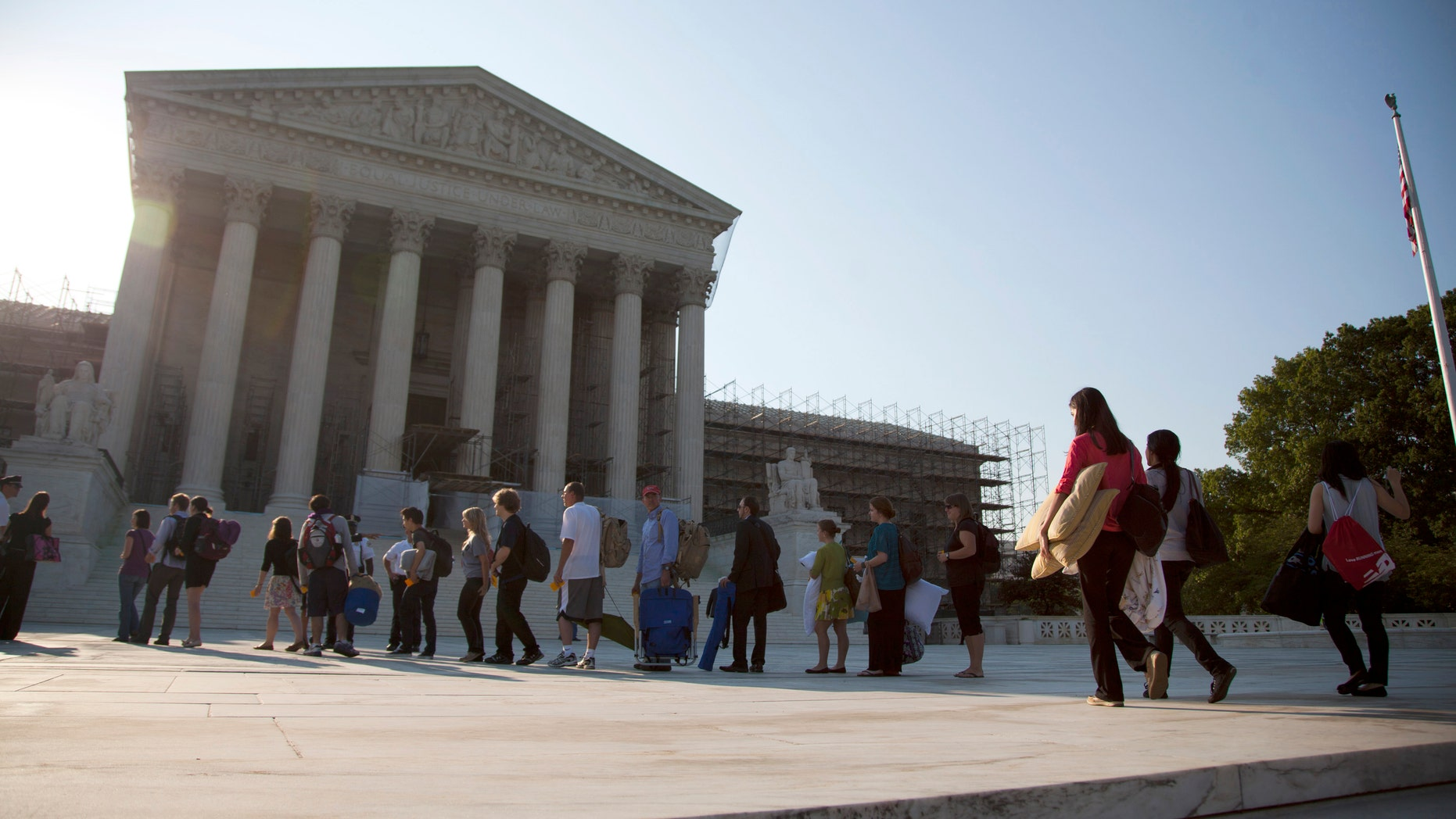 FILE - This June 28, 2012 file photo shows people waiting in line to hear cases at the Supreme Court in Washington, Thursday, June 28, 2012.  A unanimous Supreme Court ruled Monday that prosecutors may not rely on an international chemical weapons treaty to convict a woman who attacked her husband's mistress. The justices threw out the conviction of Carol Anne Bond of Lansdale, Pa., who was prosecuted under a 1999 law based on the chemical weapons treaty. Bond served a six-year prison term after being convicted of using toxic chemicals that caused a thumb burn on a friend who had become her husband's lover.  (AP Photo/Evan Vucci, File)
