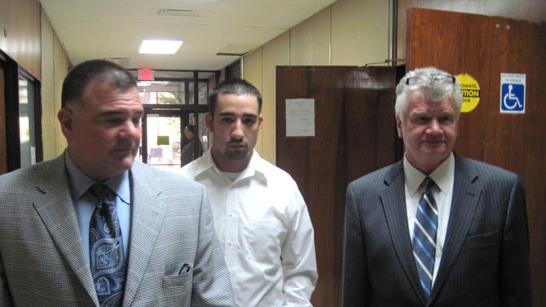 Oct. 22, 2010: Former Winnfield Police Officer Scott Nugent, center, walks with his attorneys Phillip Terrell, left and George Higgins in the Winn Parish Courthouse in Winnfield, La.