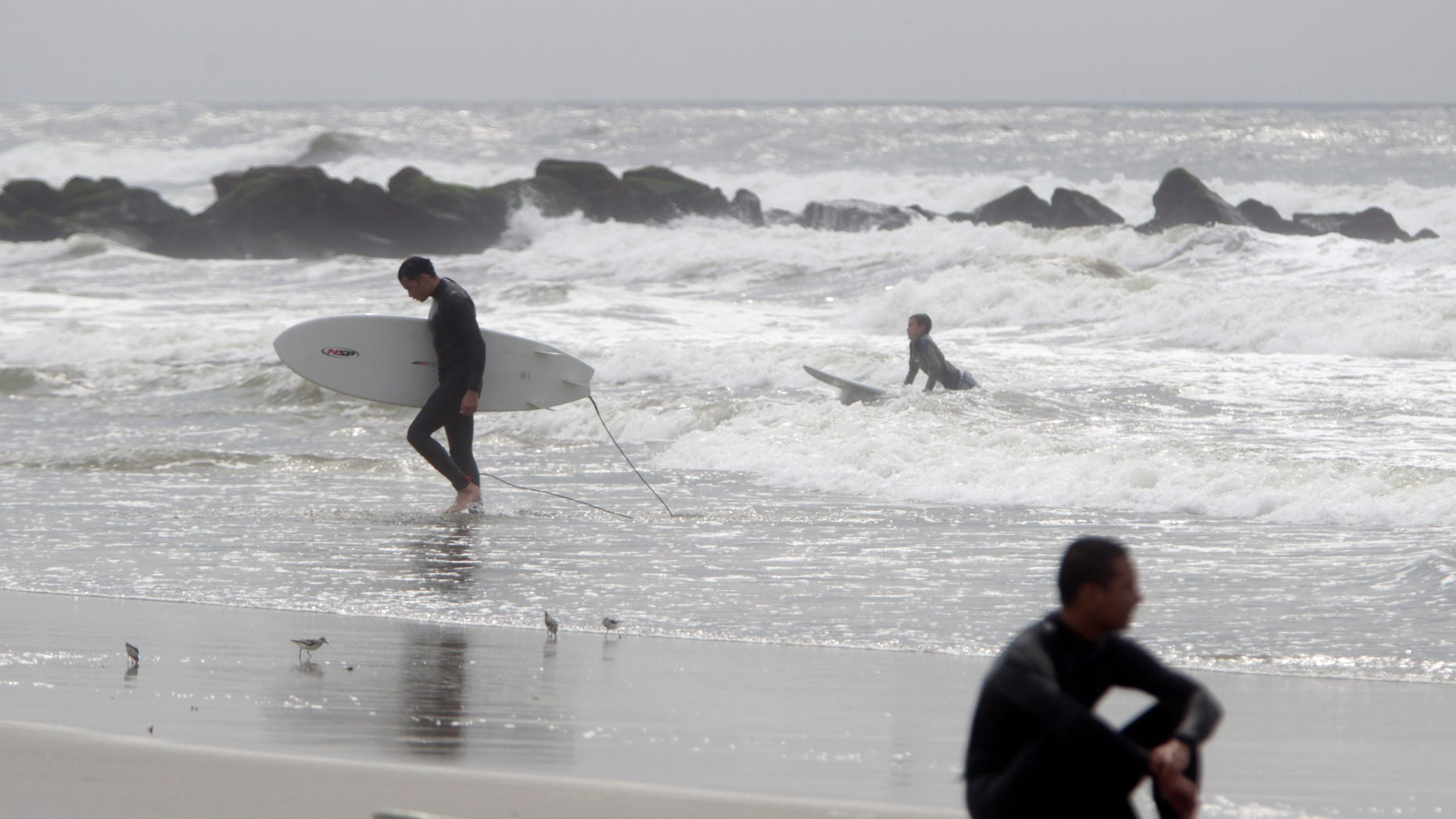 People surf in Long Beach, N.Y. The Long Island city, 50 minutes by train from Manhattan, is getting ready to play host to the Quiksilver Pro New York Surf Competition, starting Sept. 1 and running for two weeks.