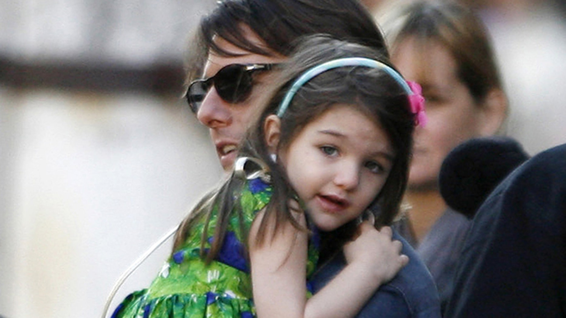 """Tom Cruise holds his daughter Suri during a break in the filming of """"Knight & Day"""", a movie directed by U.S. director James Mangold in Seville, southern Spain, December 11, 2009."""