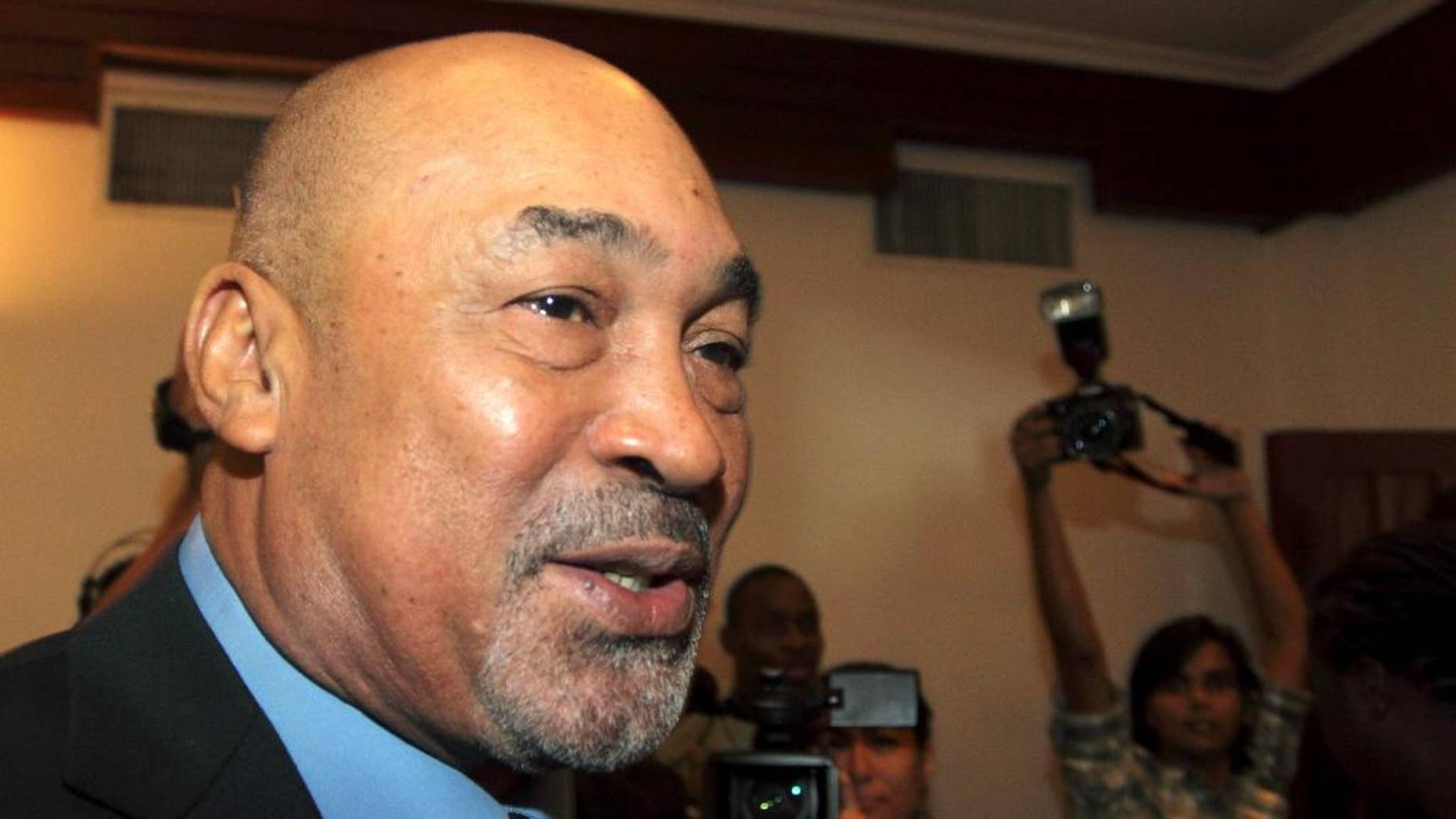 FILE - In this Sept. 2, 2010 file photo, Suriname's President Desi Bouterse speaks with journalists at the presidential cabinet office in Paramaribo, Suriname. Bouterse is betting that the Monday, May 25, 2015 election to choose the South American country's next Parliament will keep him and his party in power for another five years. (AP Photo/Edward Troon, File)