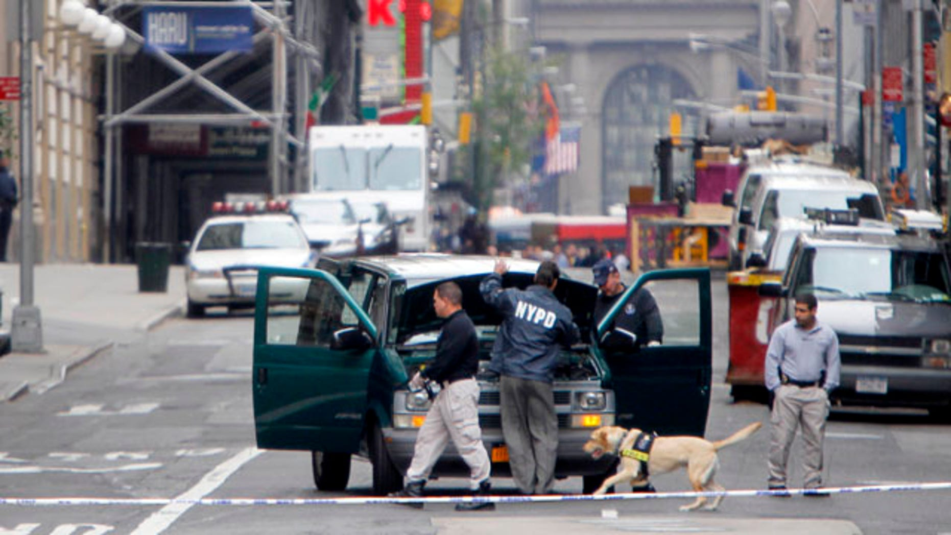 Oct. 20: Emergency personnel inspect a suspicious vehicle parked in the middle of a street near Times Square in New York. New York City police reopened streets after investigating and moving the vehicle.