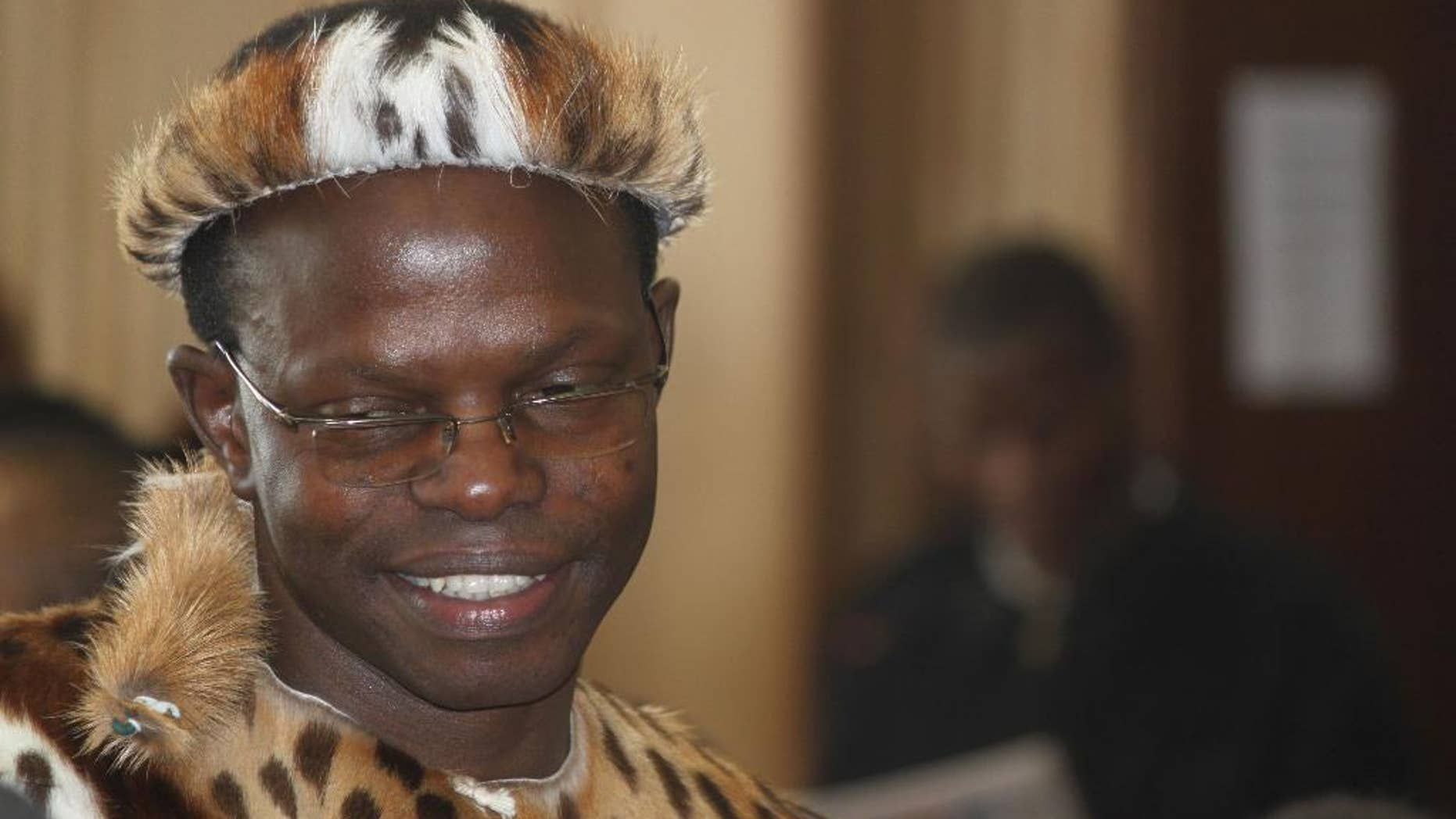 In this photo taken Wednesday, June 4, 2014, lawyer Thulani Maseko, appears in court in the traditional animal skin garb of a Zulu warrior, in Mbabane, Swaziland. Maseko delivered a blistering attack on the Swazi judiciary and political system in a trial that has focused fresh attention on human rights issues in a country who's authoritarian system gets little scrutiny in international forums because of the country's small size and strategic insignificance. (AP Photo/Nkosingiphile Myeni-The Nation Magazine)