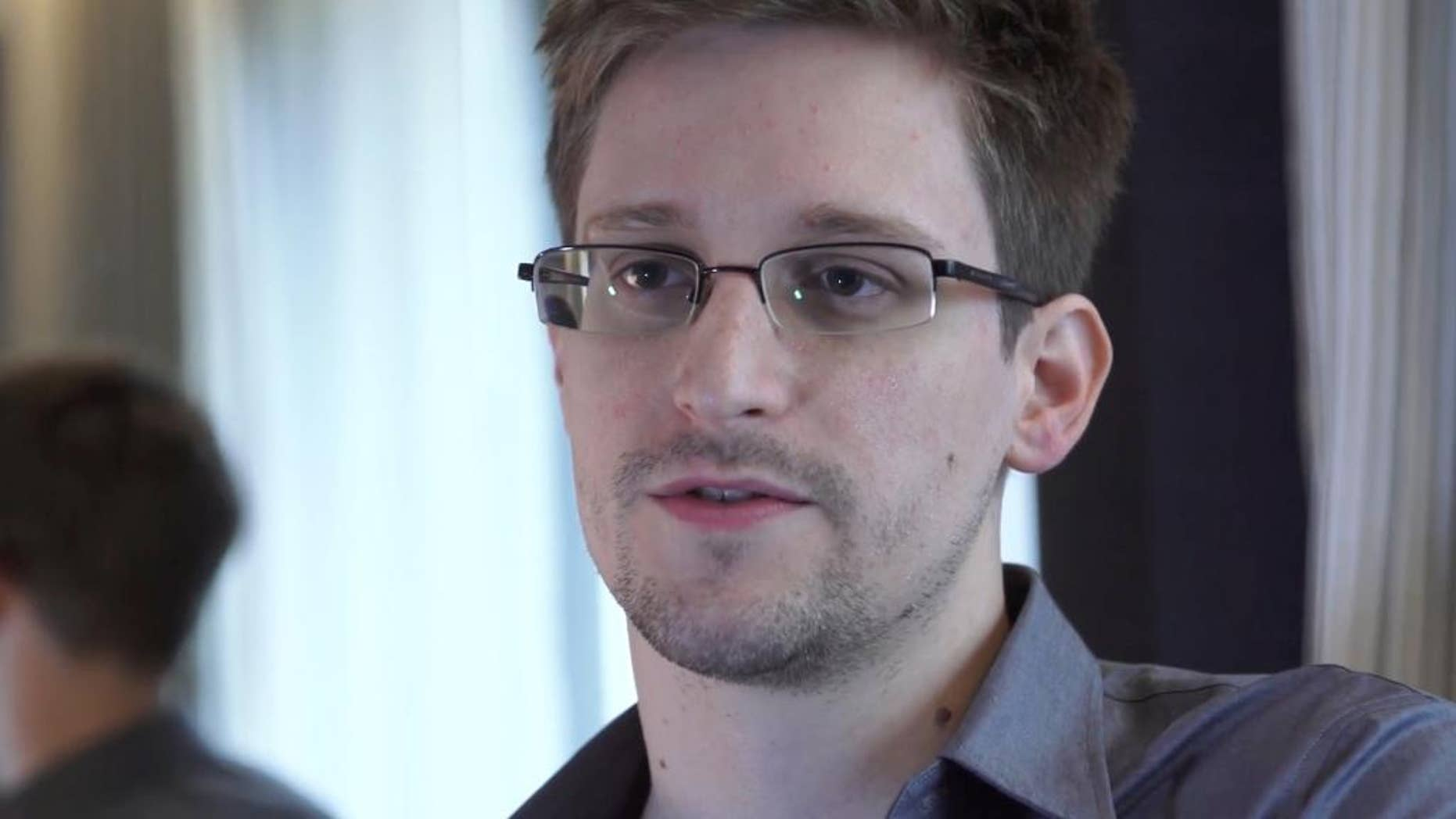 "FILE - In this June 9, 2013 file photo provided by The Guardian Newspaper in London shows Edward Snowden, who worked as a contract employee at the National Security Agency, in Hong Kong.  Edward Snowden has been selected among the winners of the Right Livelihood Award, also known as the ""alternative Nobel,"" for his disclosures of top secret surveillance programs. The award foundation on Wednesday Sept. 24, 2014  said the former National Security Agency contractor splits the honorary portion of the prize with Guardian editor Alan Rusbridger. (AP Photo/The Guardian, Glenn Greenwald and Laura Poitras, File)"