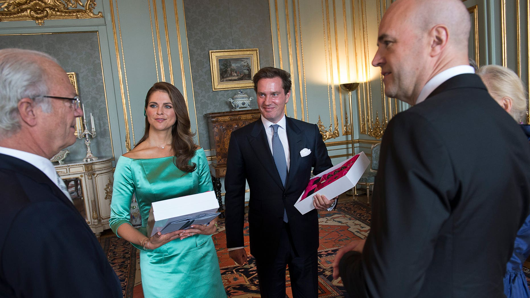 May 19, 2013: King Carl Gustaf of Sweden, left, and Swedish Prime Minister Fredrik Reinfeldt, right, congratulate Princess Madeleine and British American businessman Christopher O'Neill during the reception at the Royal Palace after the banns of marriage service for the couple, in the Royal Chapel in Stockholm, Sweden.