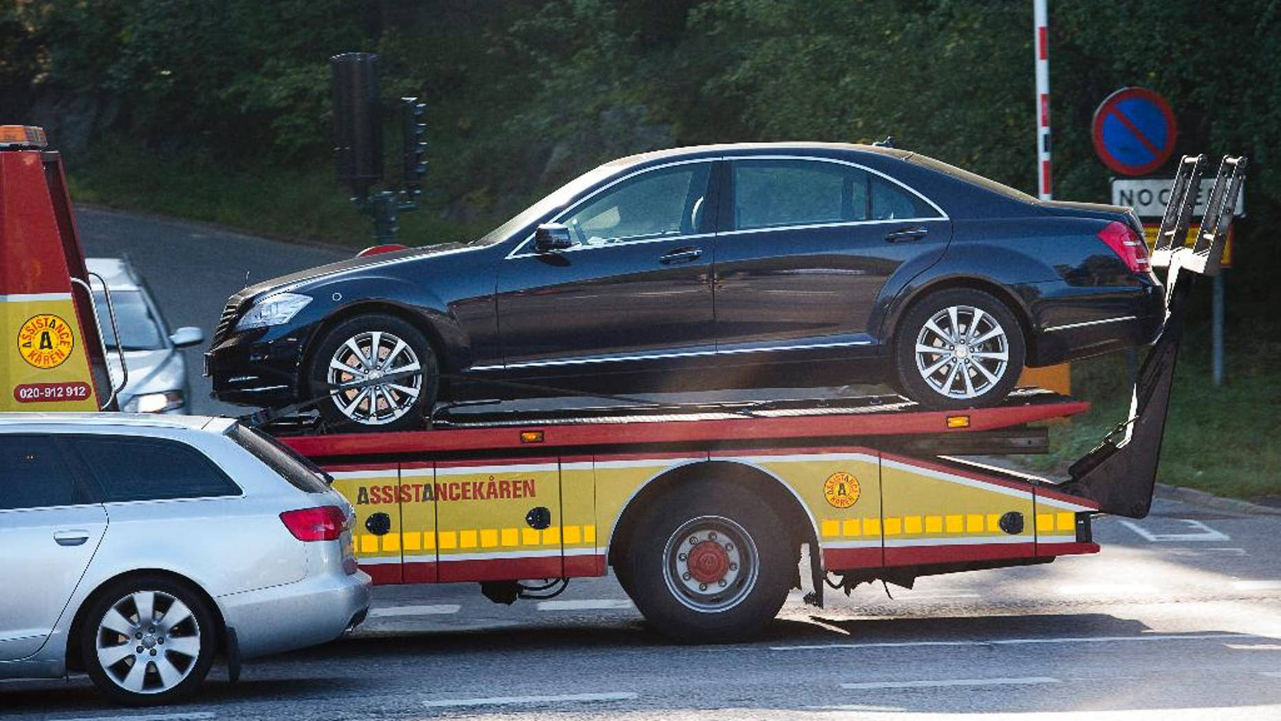 The vehicle involved in an accident involving Sweden's King Carl XVI Gustaf, is towed away from the scene, in Stockholm, Sweden, Wednesday, Sept. 17, 2014. Sweden's royal palace says King Carl XVI Gustaf was involved in a car crash on his way to an airport in Stockholm but was unhurt. Palace spokeswoman Annika Sonnerberg says the 68-year-old king was in the back seat Wednesday when his car collided with an oncoming vehicle making a left turn. (AP Photo/TT News Agency, Jonas Ekstromer) SWEDEN OUT