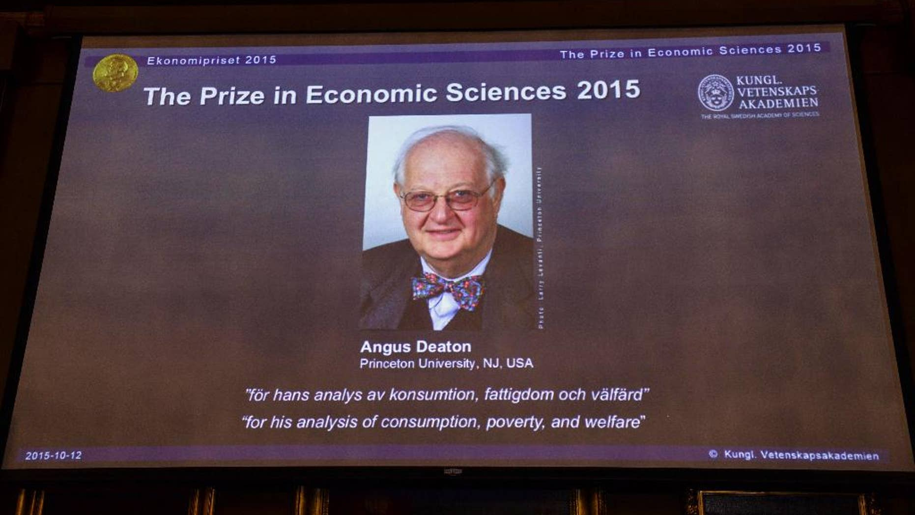 """A view of the screen showing an image of Professor Angus Deaton, winner of the 2015 Sveriges Riksbank Prize in Economic Sciences in Memory of Alfred Nobel, as the Permanent Secretary for the Royal Swedish Academy of Sciences addresses a press conference to announce the winner of the prize, at the Royal Swedish Academy of Science, in Stockholm, Sweden, Monday, Oct. 12, 2015. Scottish economist Angus Deaton has won the Nobel memorial prize in economic sciences for """"his analysis of consumption, poverty, and welfare,"""" the Royal Swedish Academy of Sciences said Monday.  (Maja Suslin/TT News Agency via AP)"""
