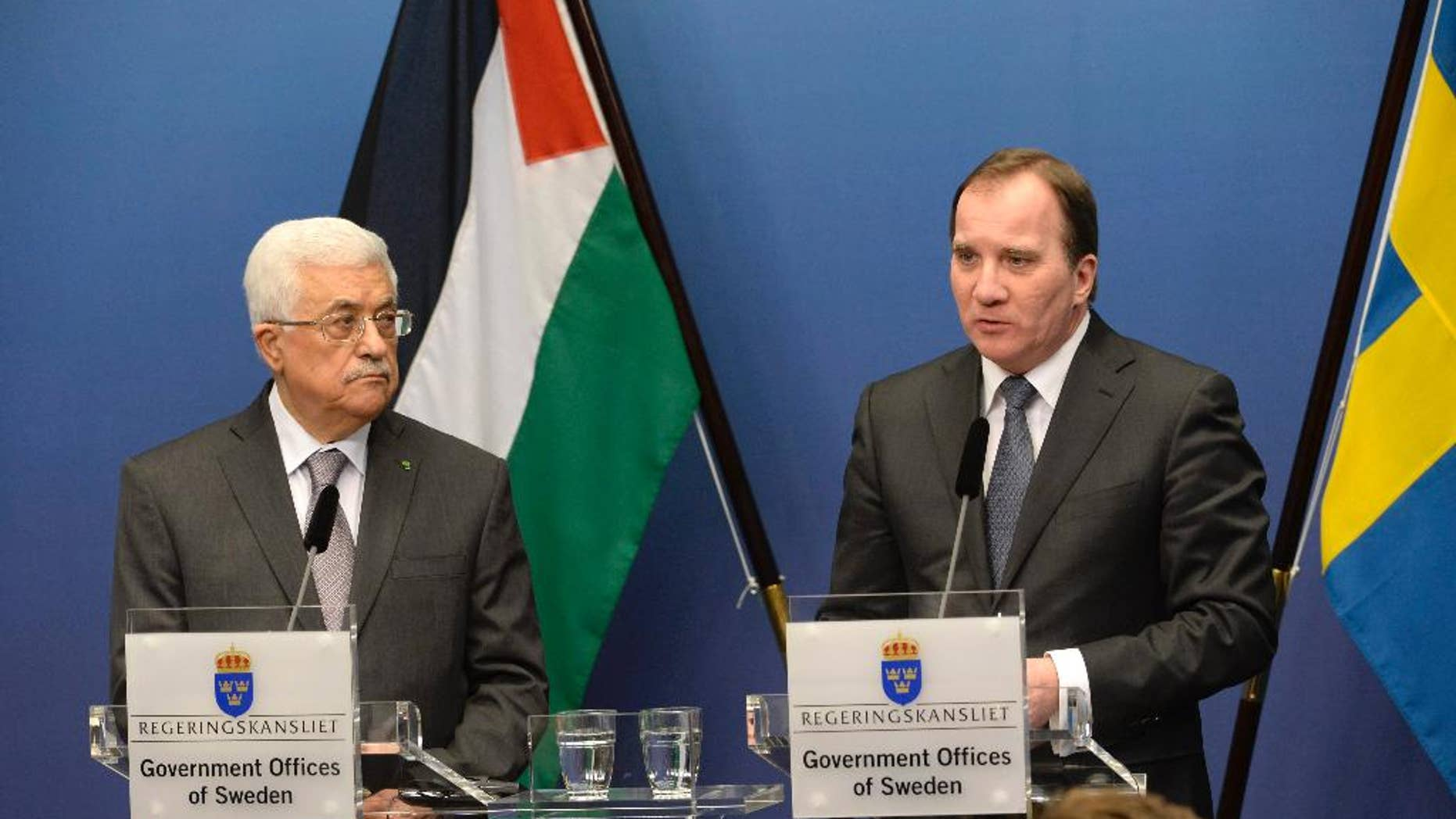 Palestinian President Mahmoud Abbas, left, and Sweden's Prime Minister Stefan Lofven during a press conference at the government headquarters Rosenbad in Stockholm, Sweden Tuesday, Feb. 10, 2015.  President Abbas is on a one day official visit to Sweden. (AP Photo/TT/ Jonas Ekstromer ) SWEDEN OUT