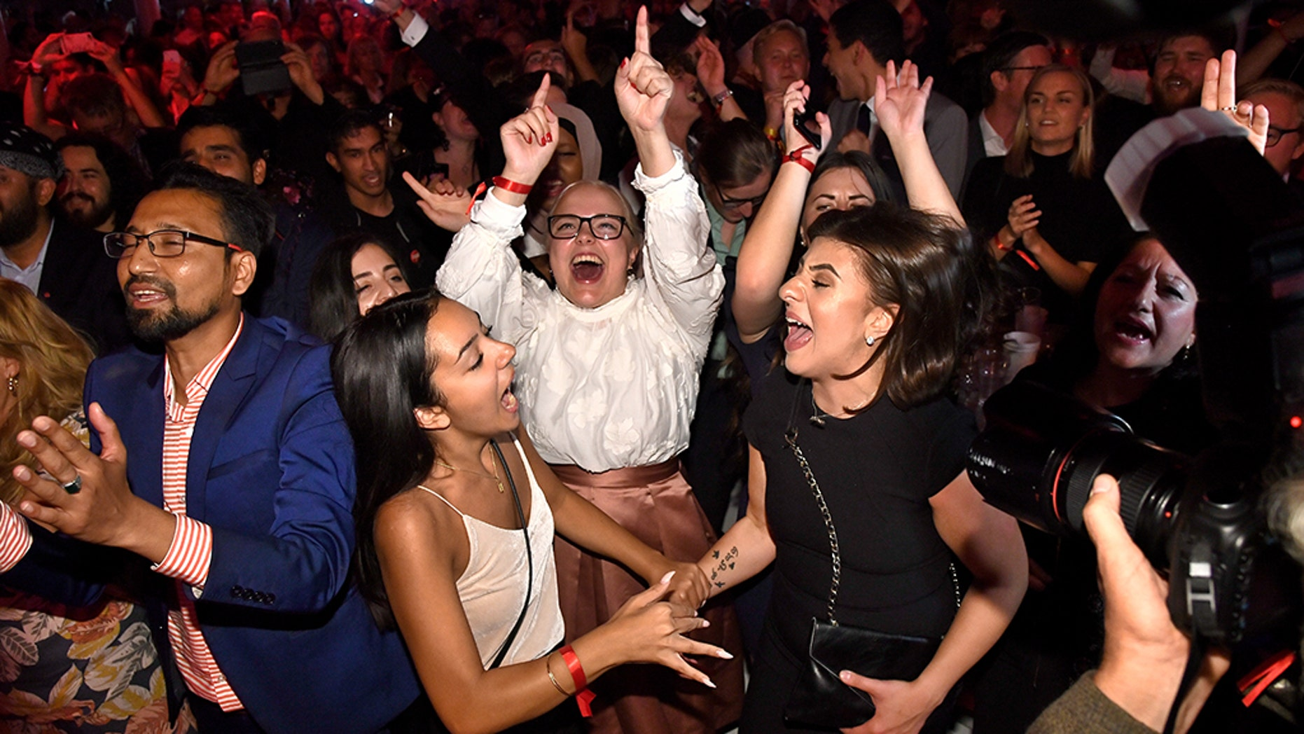 Supporters attend the Social Democratic Party's election night party in Stockholm, Sweden, Sunday. A preliminary count from Sweden's general election showed an anti-immigrant party with a neo-Nazi past placing third and the ruling center-right party making its worst showing in decades with more than half of the ballots tallied.