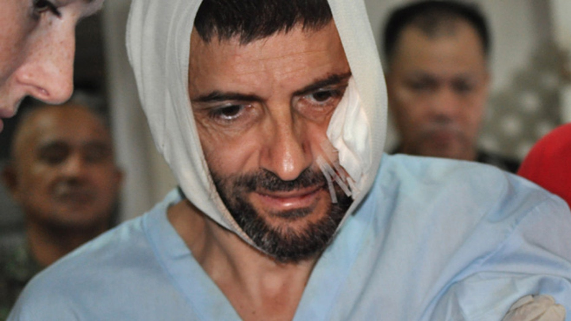 Dec. 6: Swiss hostage Lorenzo Vinciguerra, is treated in a hospital following his daring escape from the hands of the Muslim Abu Sayyaf extremists, in Jolo in southern Philippines.