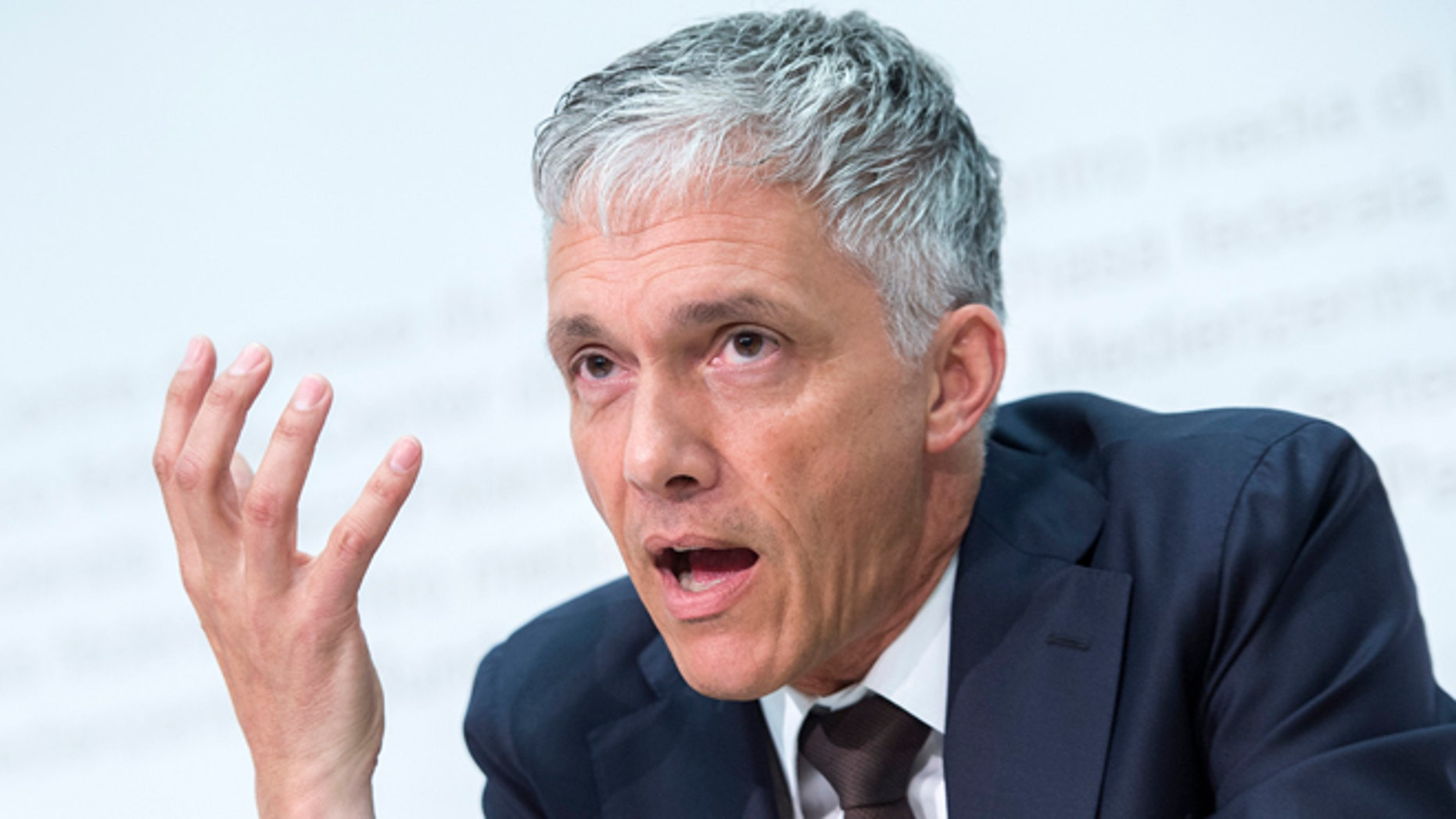 Swiss attorney general Michael Lauber speaks during a press conference in Bern, Switzerland, Wednesday, June 17, 2015. Lauber said that banks have noted 53 possible money-laundering cases in a FIFA probe. (Marcel Bieri/Keystone via AP)