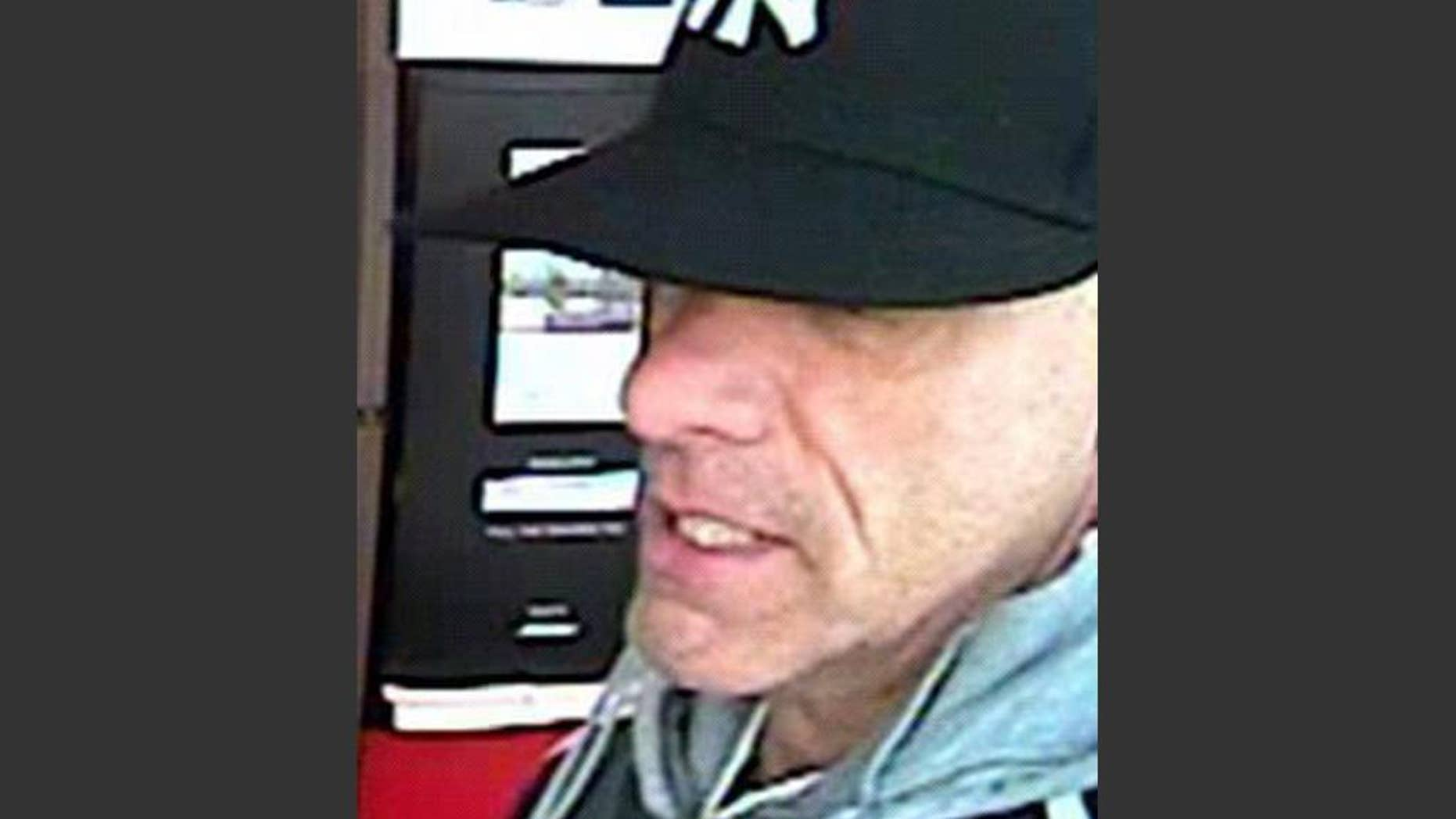 """This undated surveillance photo provided by the York Regional Police shows a bank robbery suspect, not identified by name, but nicknamed """"The Vaulter Bandit."""" On Tuesday, Sept. 15, 2015, Geneva police arrested the suspect, who had been sought under an international arrest warrant issued by Canada in connection with 22 bank robberies over the last five years. (Courtesy of York Regional Police/The Canadian Press via AP)"""