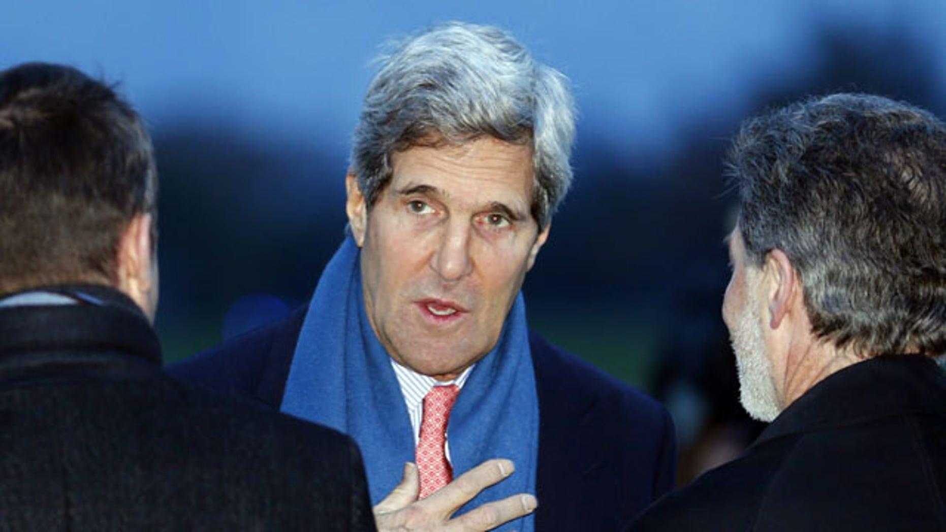 November 23, 2013: U.S. Secretary of State John Kerry arrives at Geneva International Airport in Geneva, Switzerland for the Iran nuclear talks. (AP Photo/Denis Balibouse Pool)