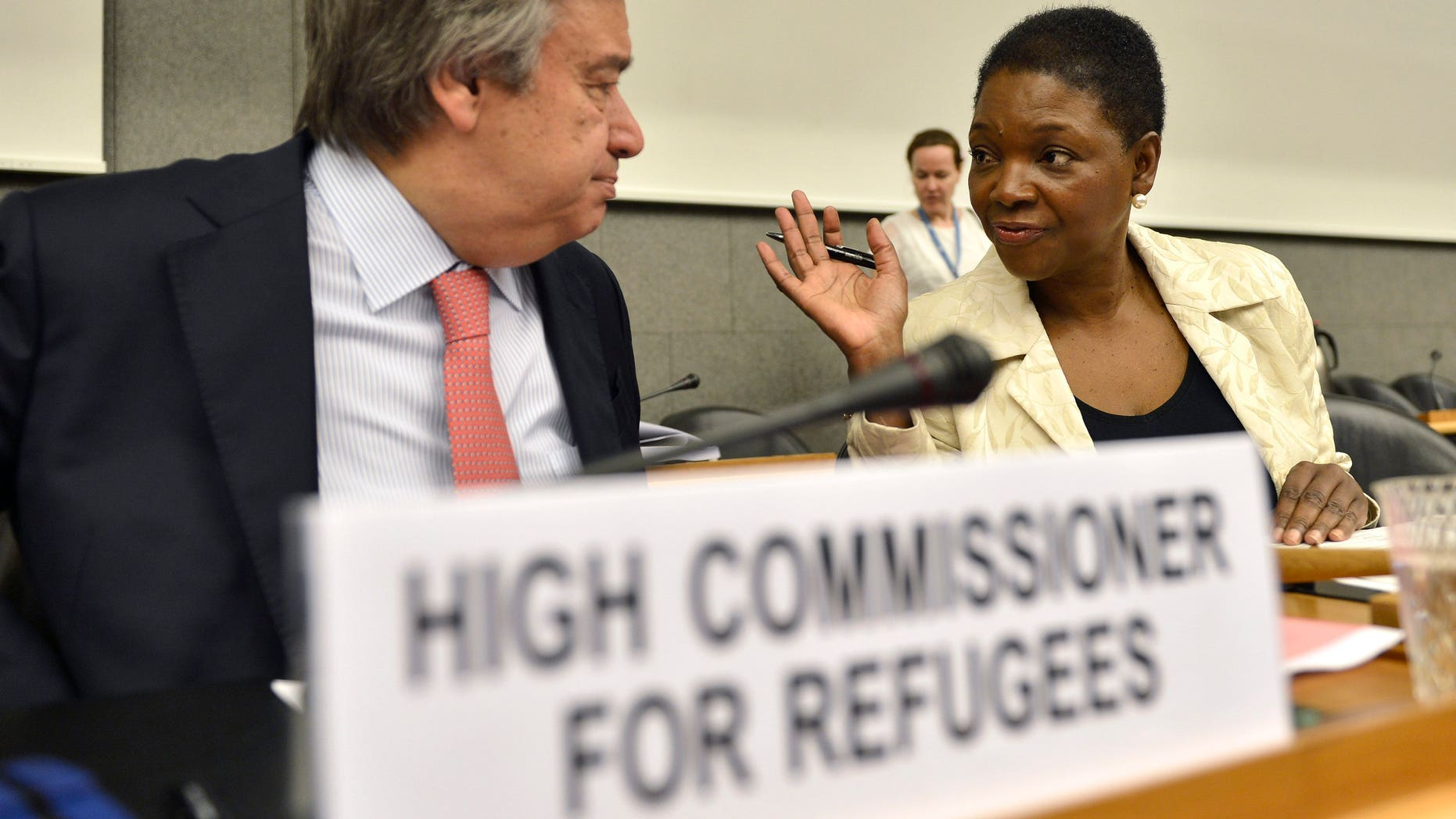 Valerie Amos, right, Under-Secretary-General and Emergency Relief Coordinator of the United Nations Office for the Coordination of Humanitarian Affairs, OCHA, speaks with Antonio Guterres, left, United Nations High Commissioner for Refugees, prior to a meeting for the launch of the Regional Response Plan for Syrian Refugees and Syrian Humanitarian Assistance Response Plan, at the World Trade Organisation (WTO) headquarters in Geneva, Switzerland, Friday, June 7, 2013. (AP Photo/Keystone, Martial Trezzini)
