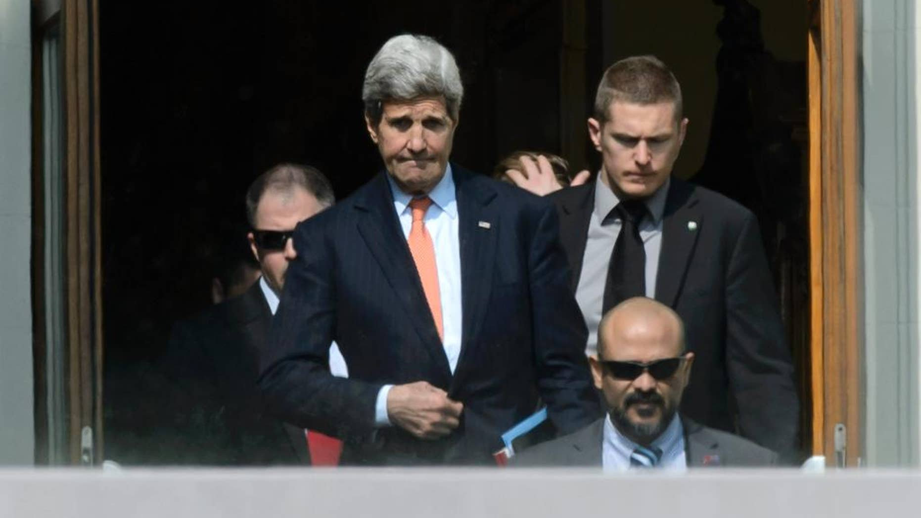 U.S. Secretary of State John Kerry, center, walks outside the hotel during a break from a bilateral meeting with Iranian Foreign Minister Mohammad Javad Zarif for a new round of Nuclear Talks, in Lausanne, Switzerland, Thursday, March 19, 2015.  (AP Photo/Keystone,Laurent Gillieron)