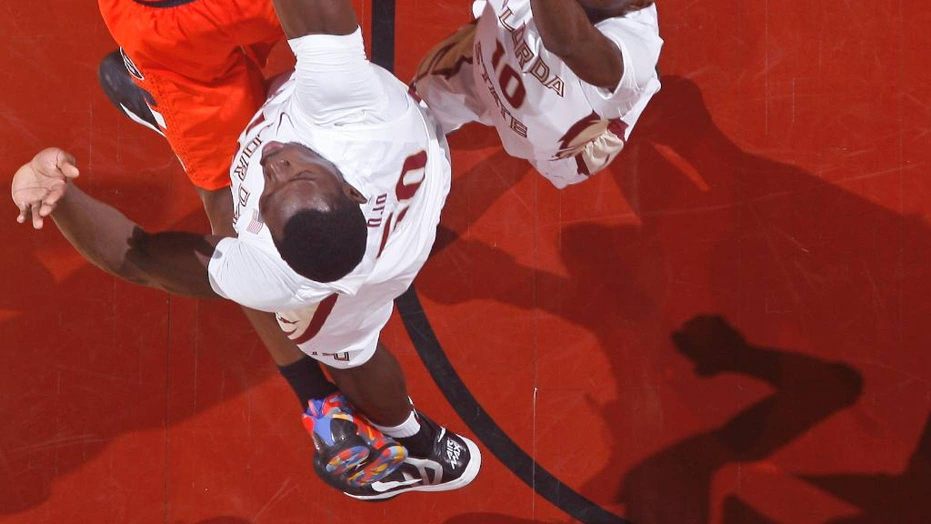 Syracuse forward Jerami Grant, top left, is fouled by Florida State center Michael Ojo (50) as Florida State forward Okaro White (10) defends in the first half of an NCAA college basketball game on Sunday, March 9, 2014, in Tallahassee, Fla. (AP Photo/Phil Sears)