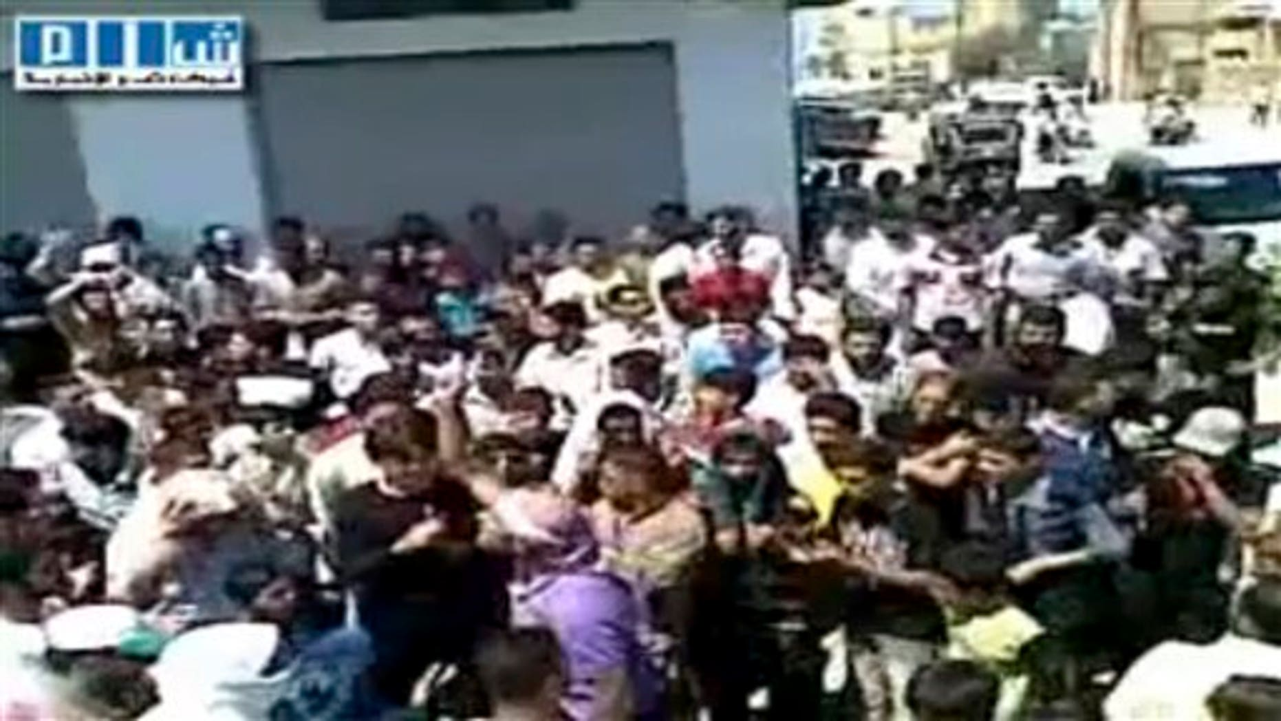 Aug. 12, 2011: This image made from amateur video released by Shams News Network and accessed via The Associated Press Television News shows a protest march in Hama Syria.